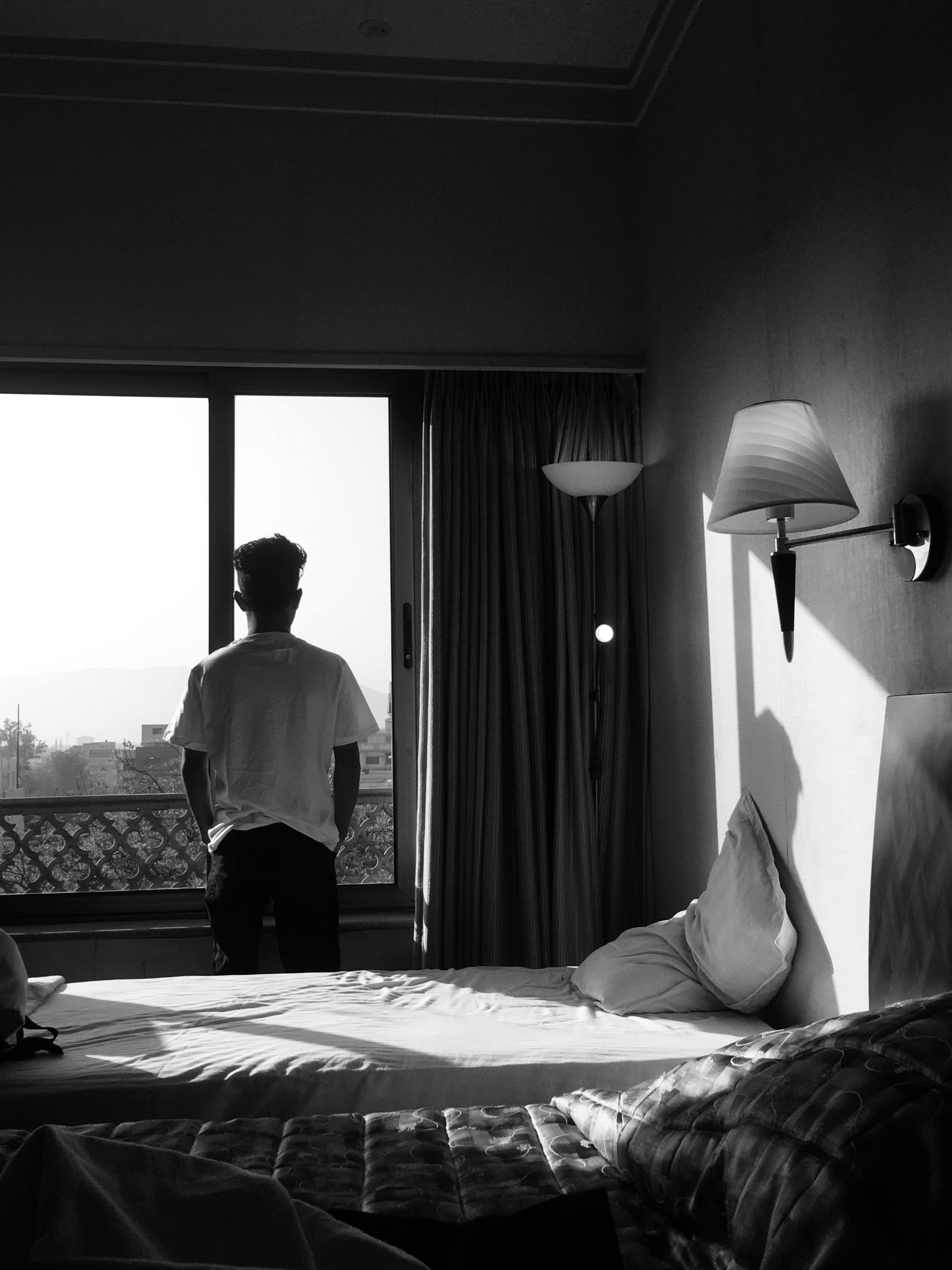 Man standing by the bed