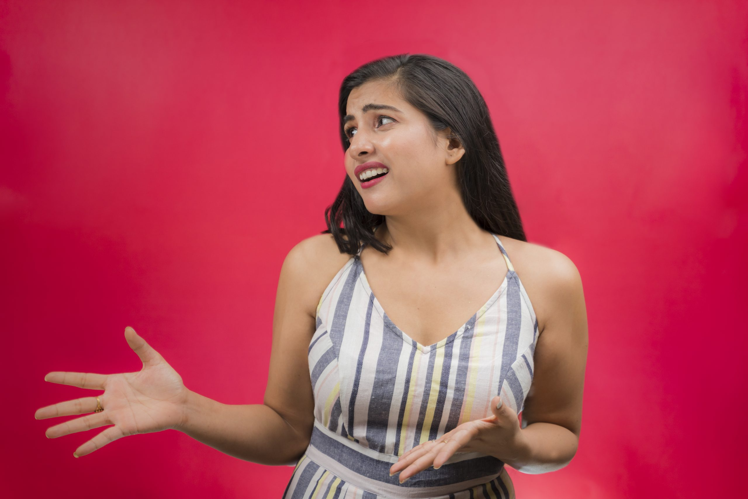 Shocked girl pointing hands