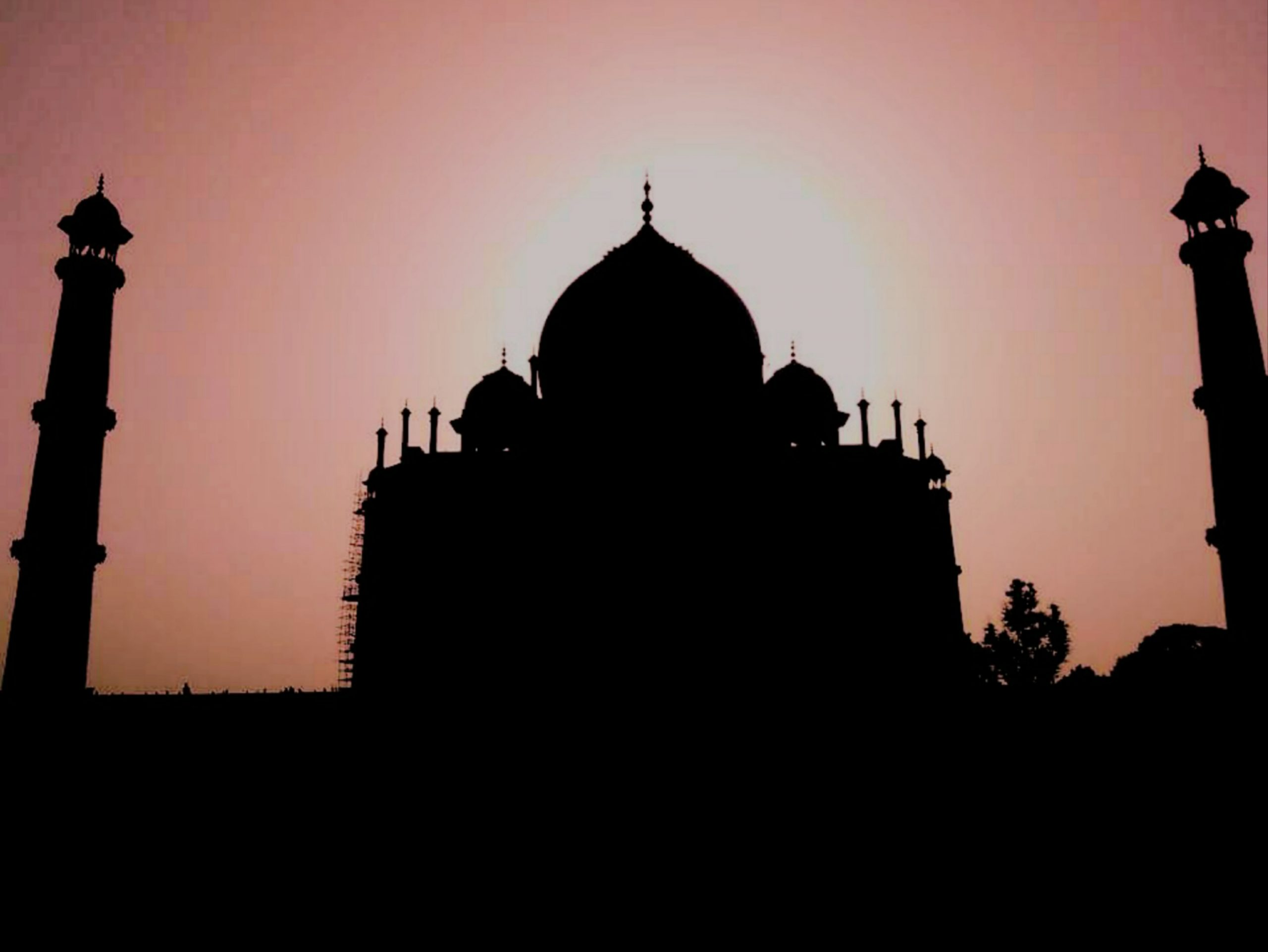 Silhouette of the Taj Mahal during sunset.