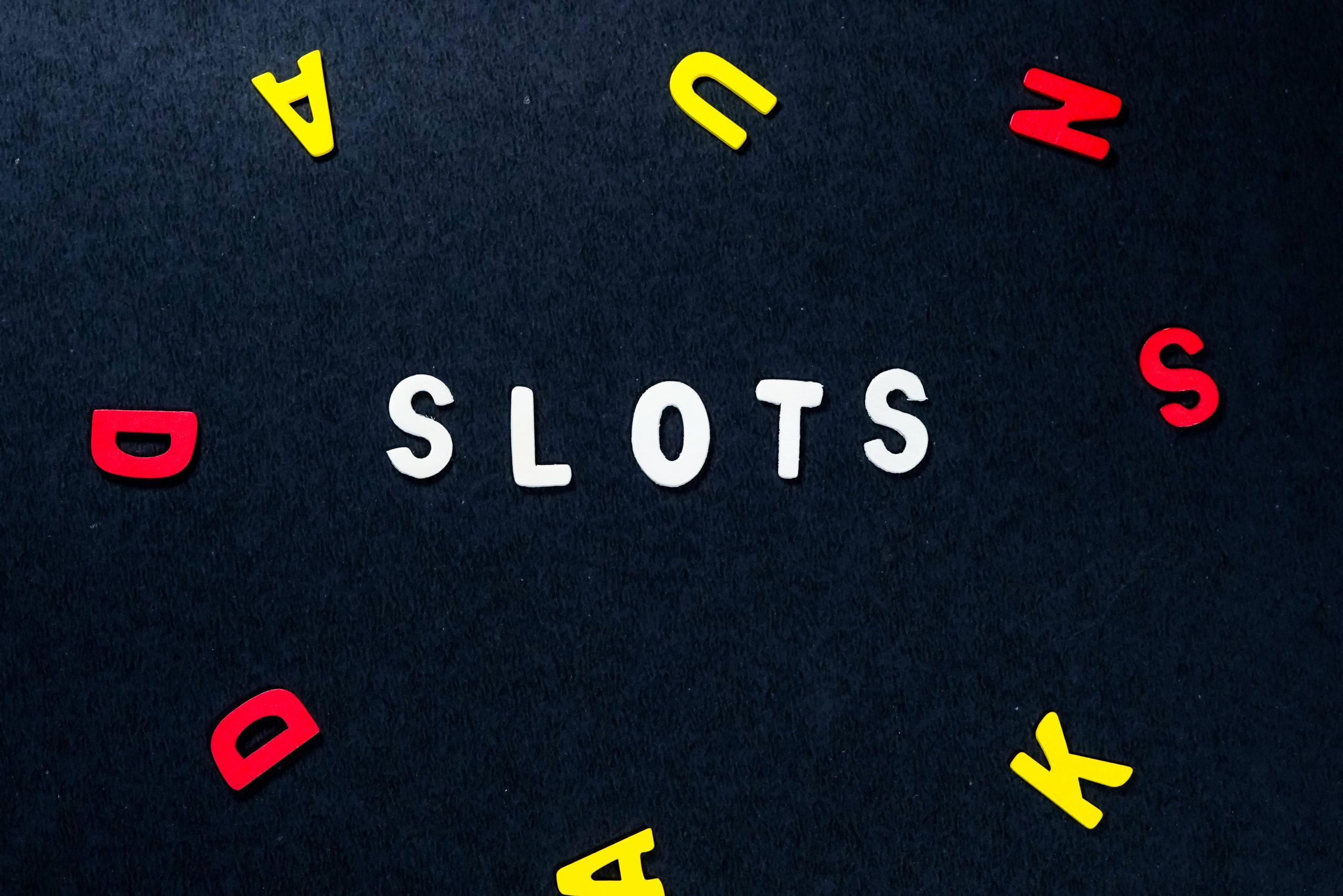 Slots written on scrabble