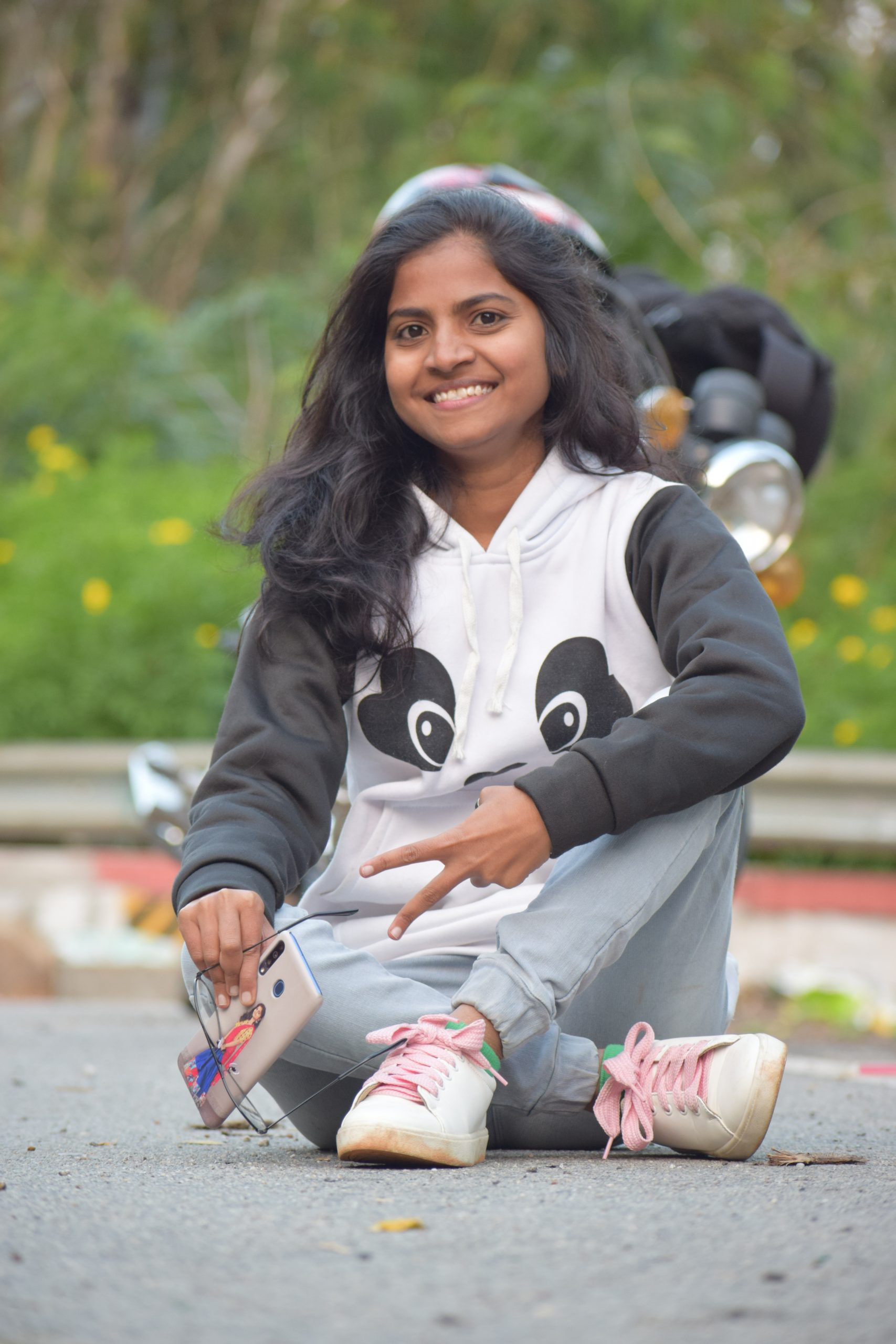 Girl sitting on the ground and smiling