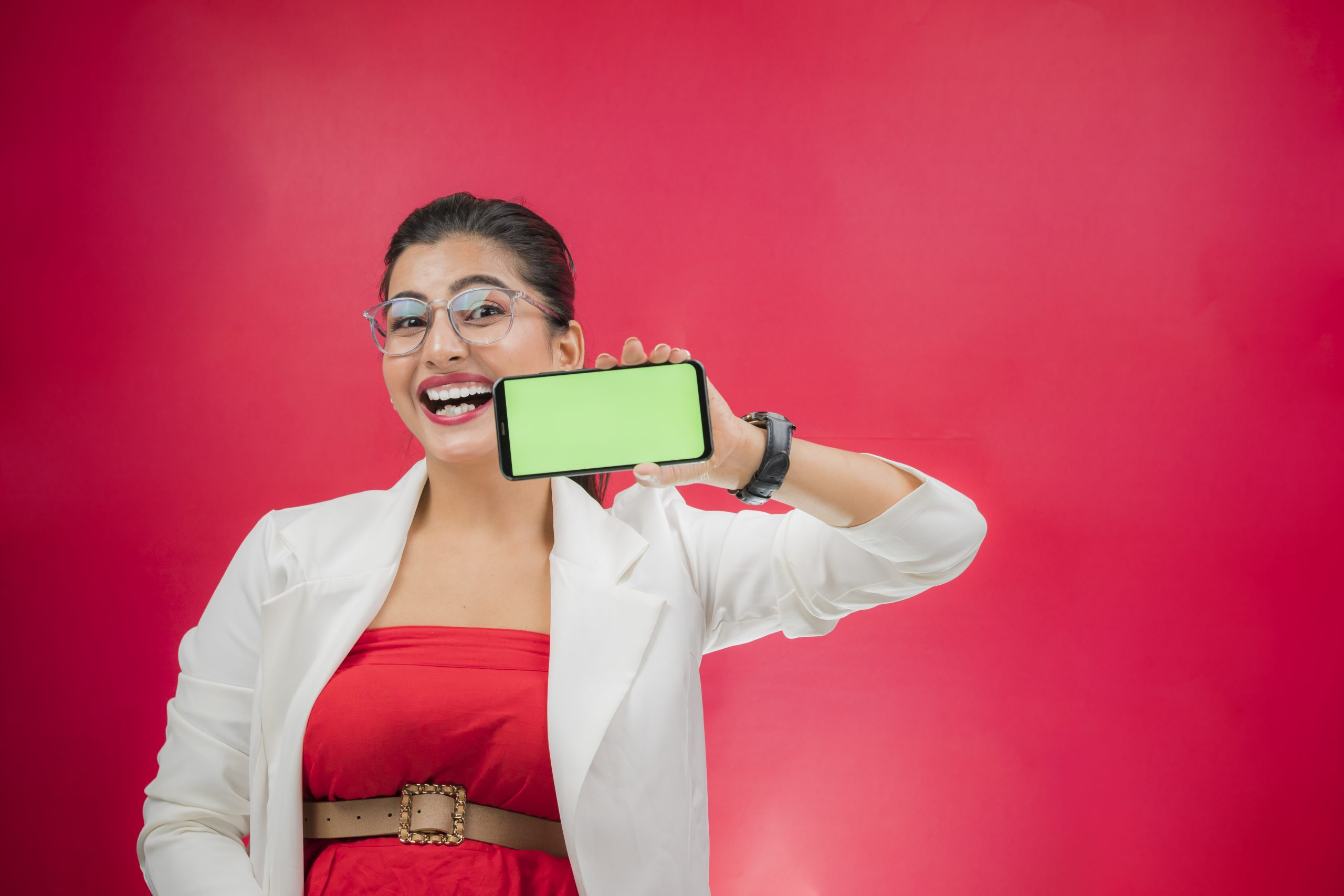Smiling professional woman showing phone screen