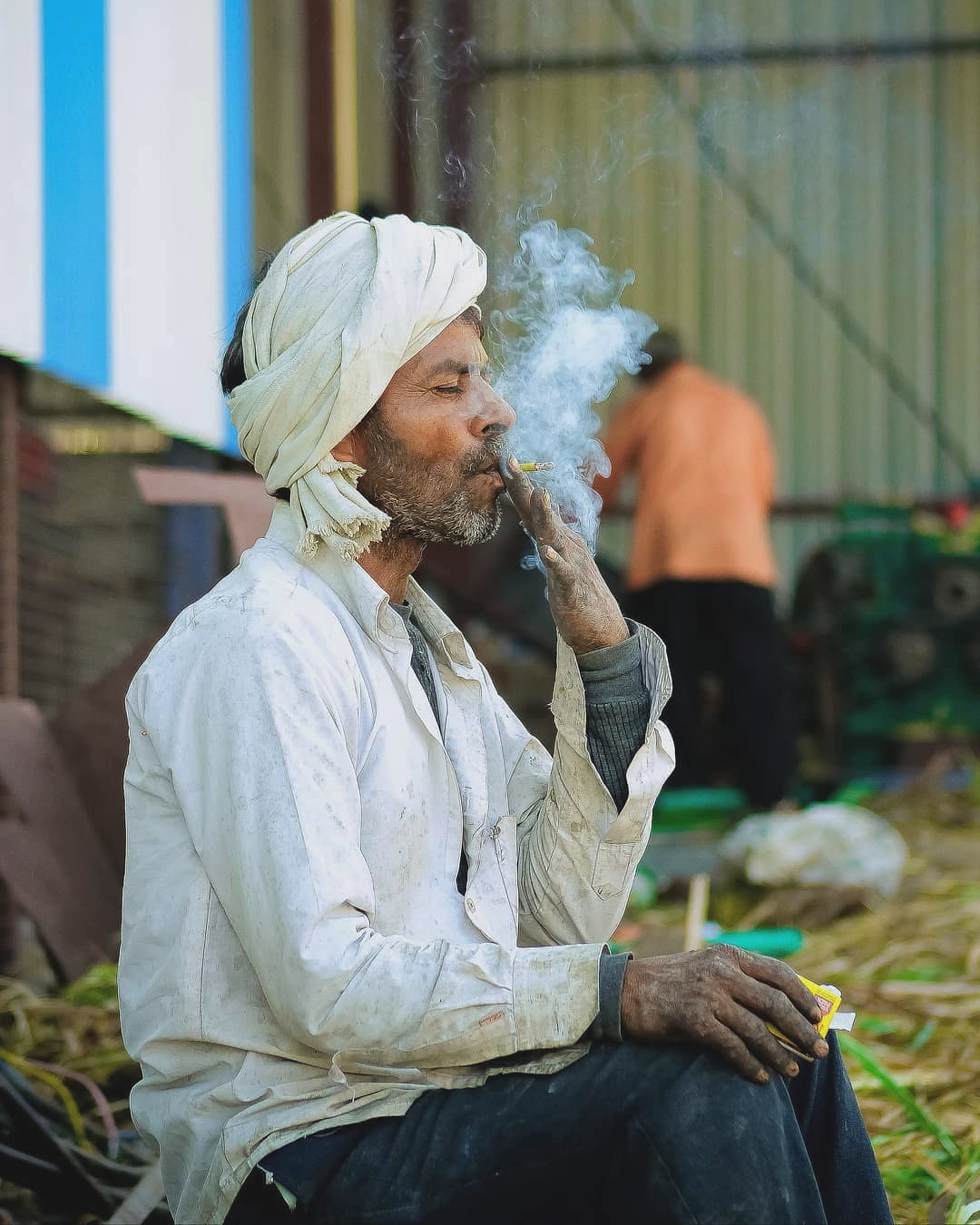 A man smoking cigarettes.