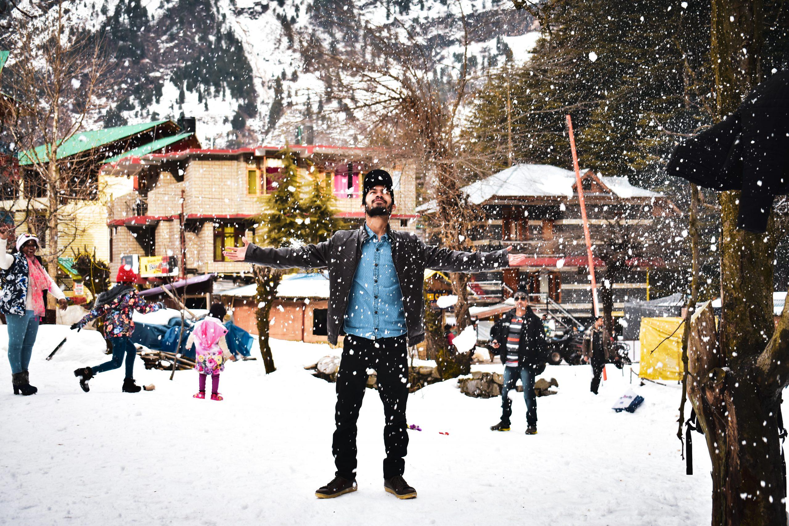 Tourist enjoying snowfall