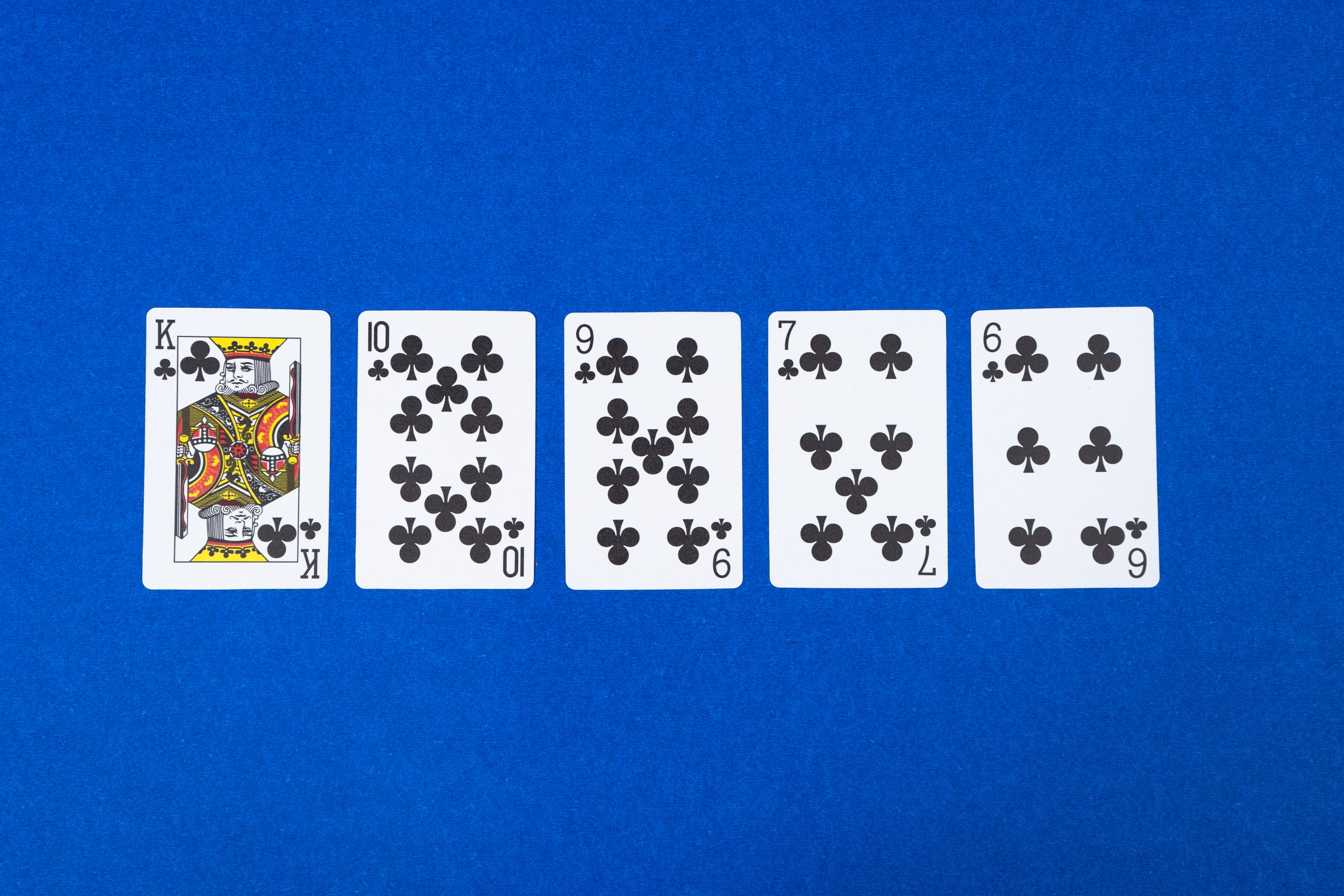 Straight flush Poker on Blue Background