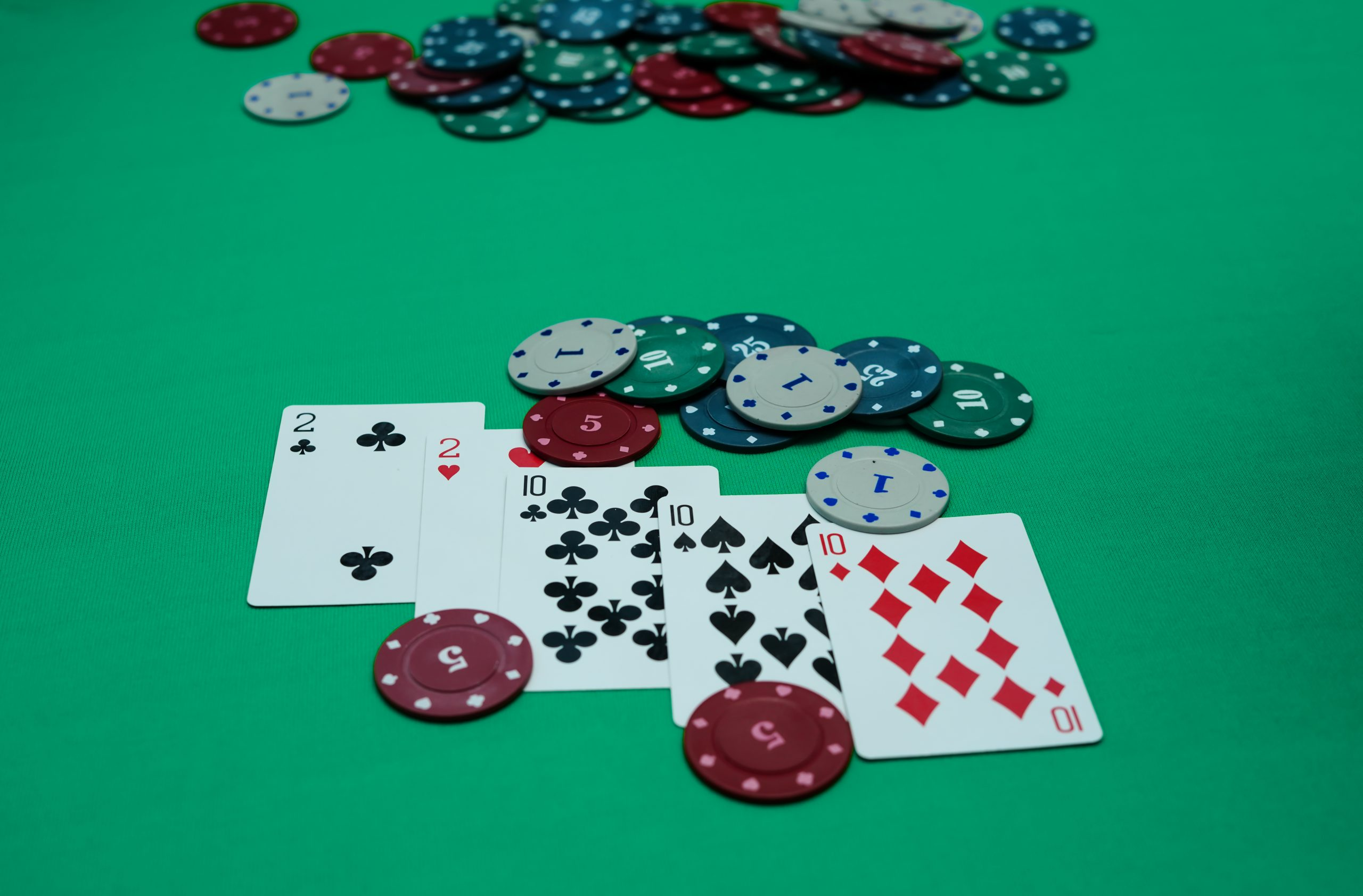 Poker studs and cards on a table.