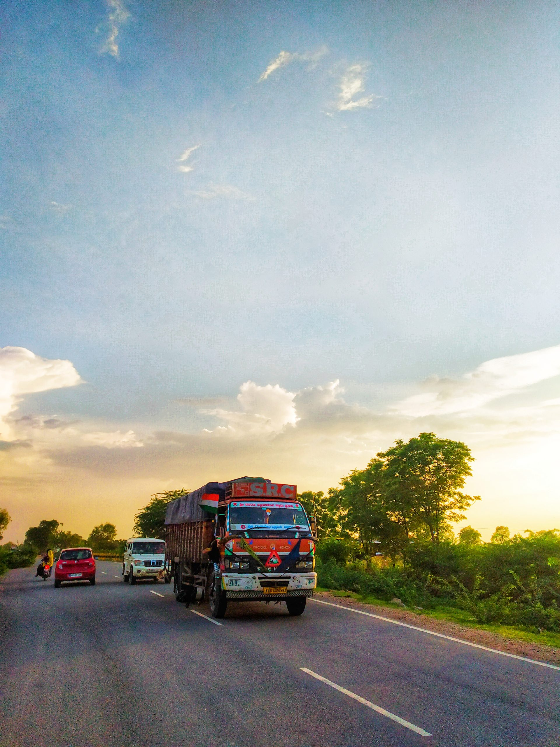 Vehicles on a highway in evening.