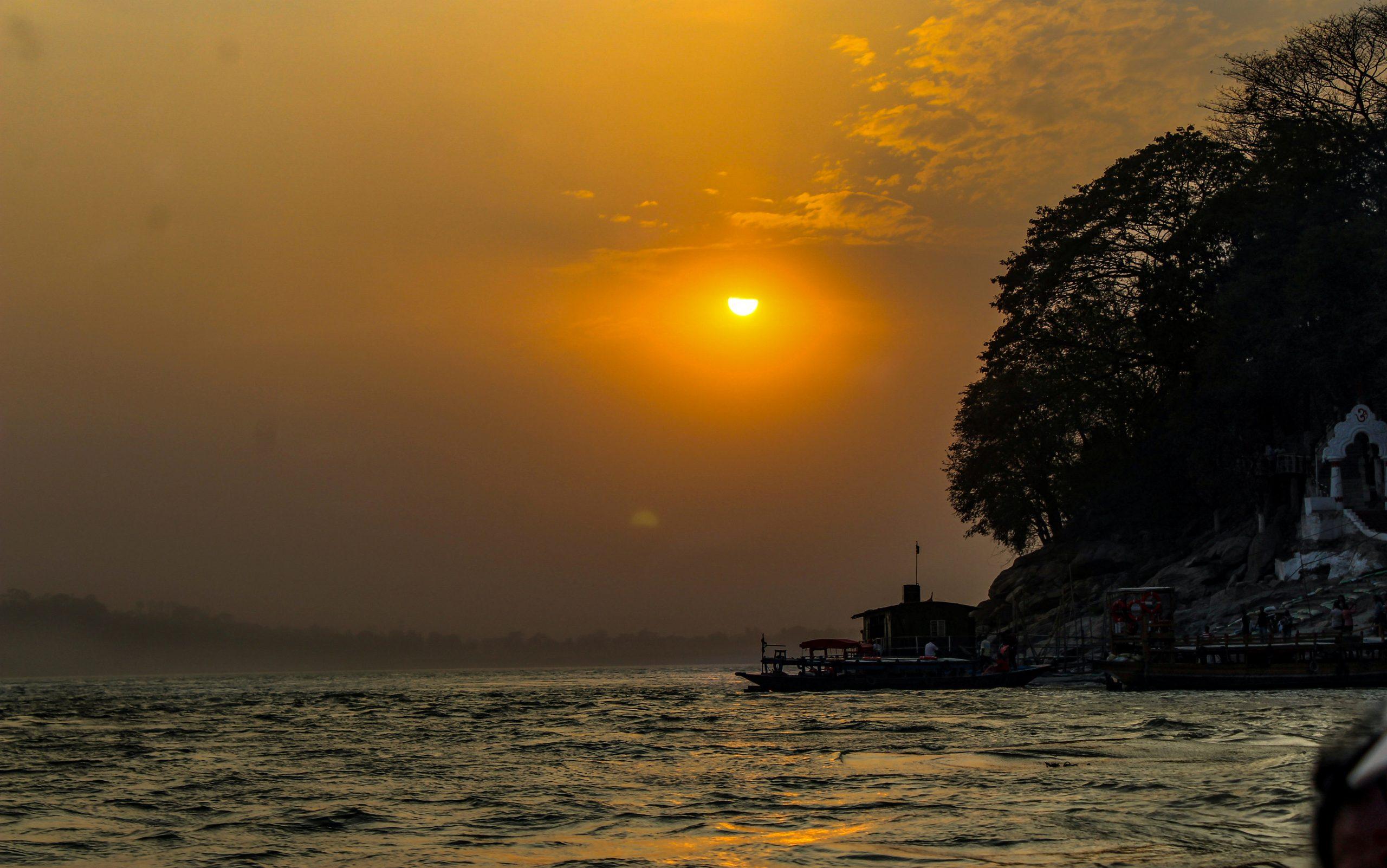 Sunset through a river