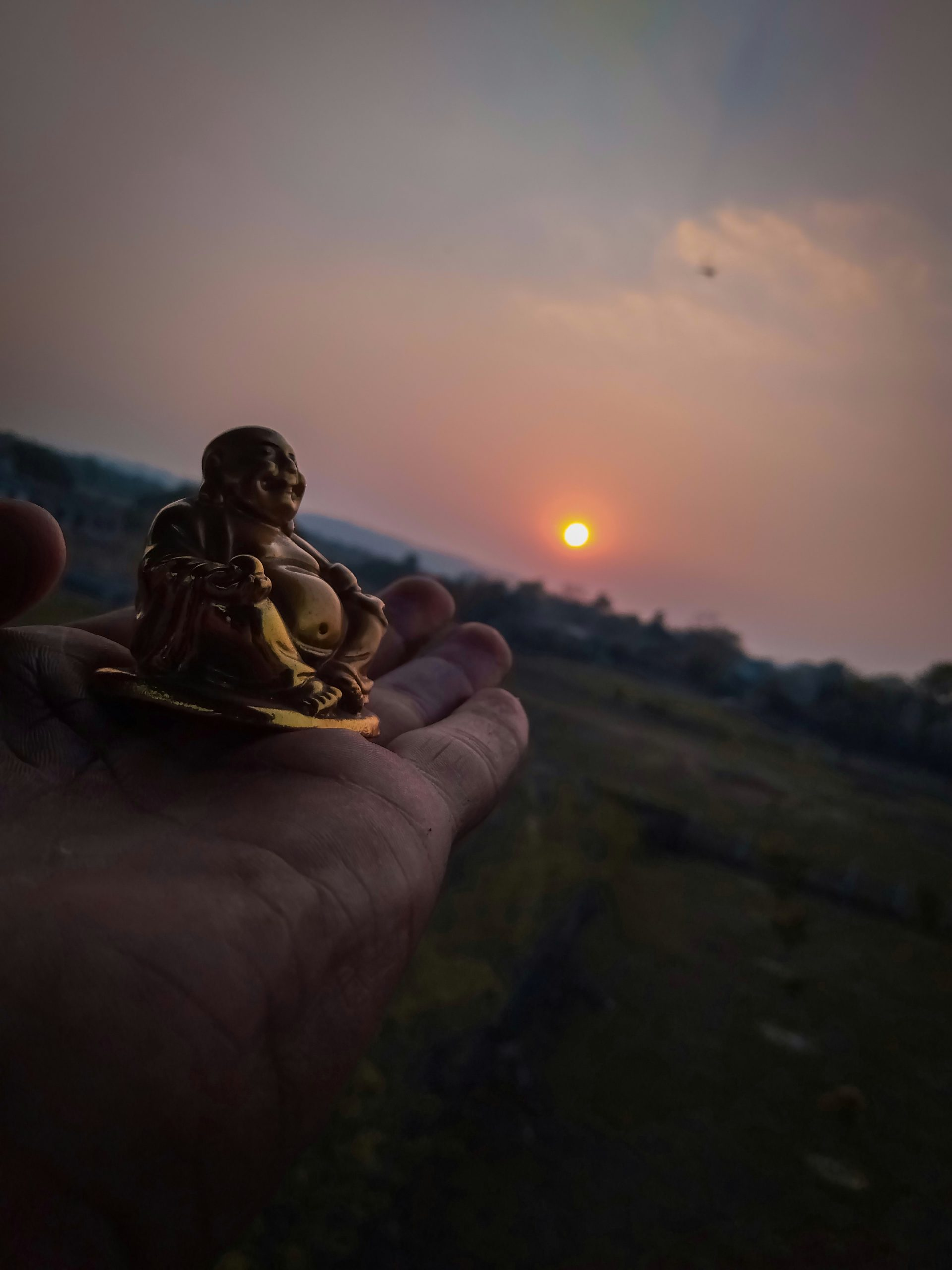 Sunset with Laughing Buddha