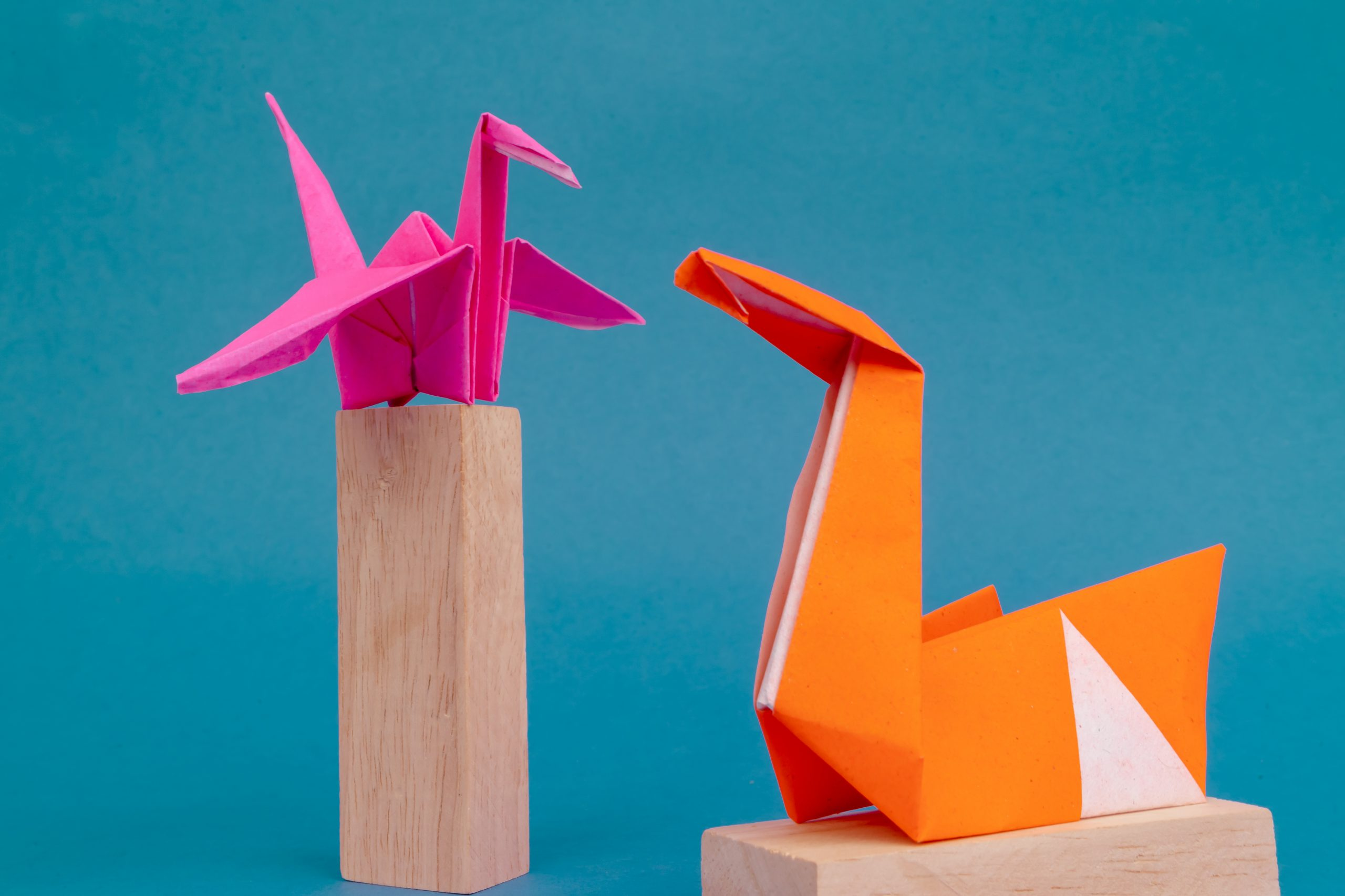 Swan and crane origami on wooden blocks