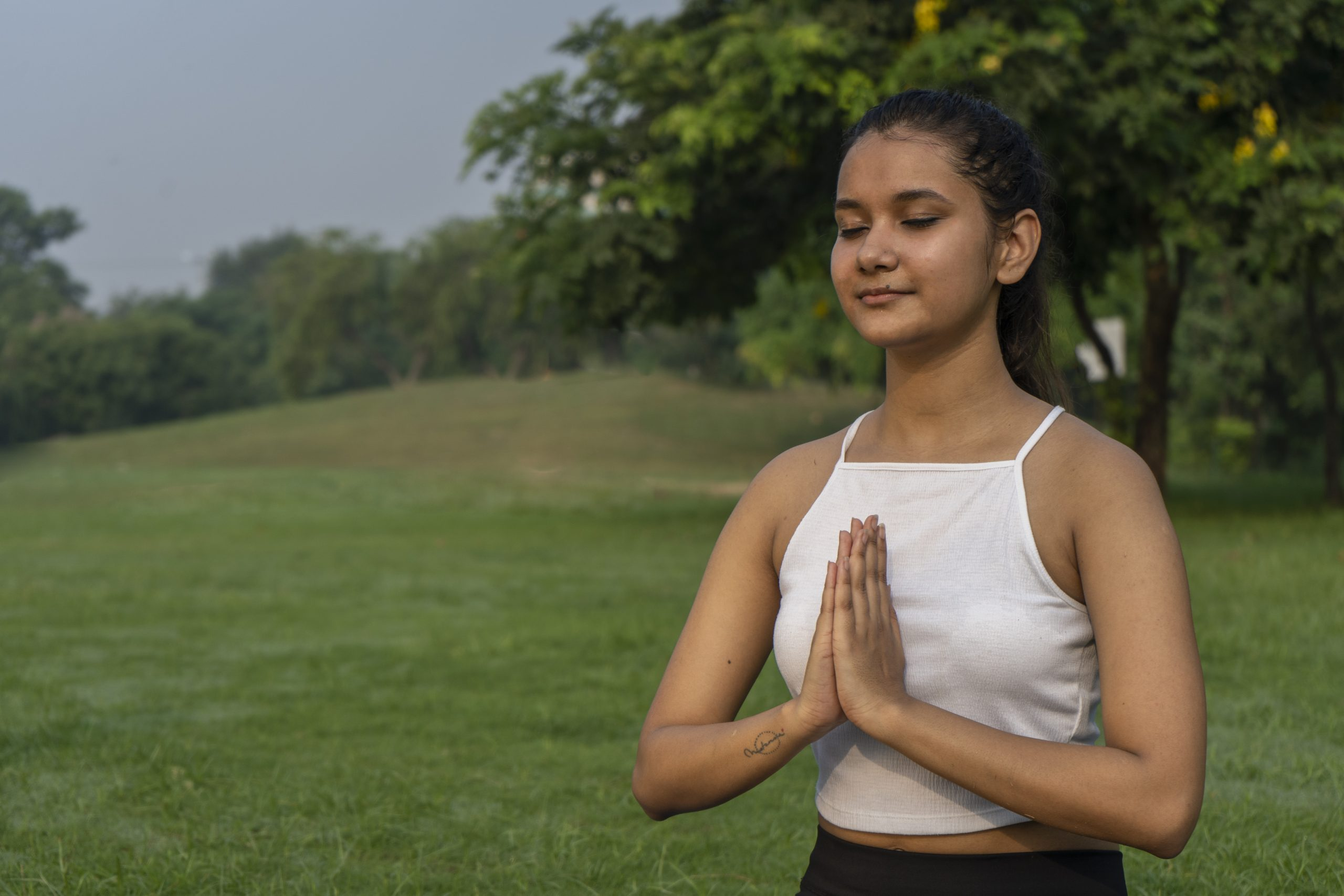A girl performing meditation