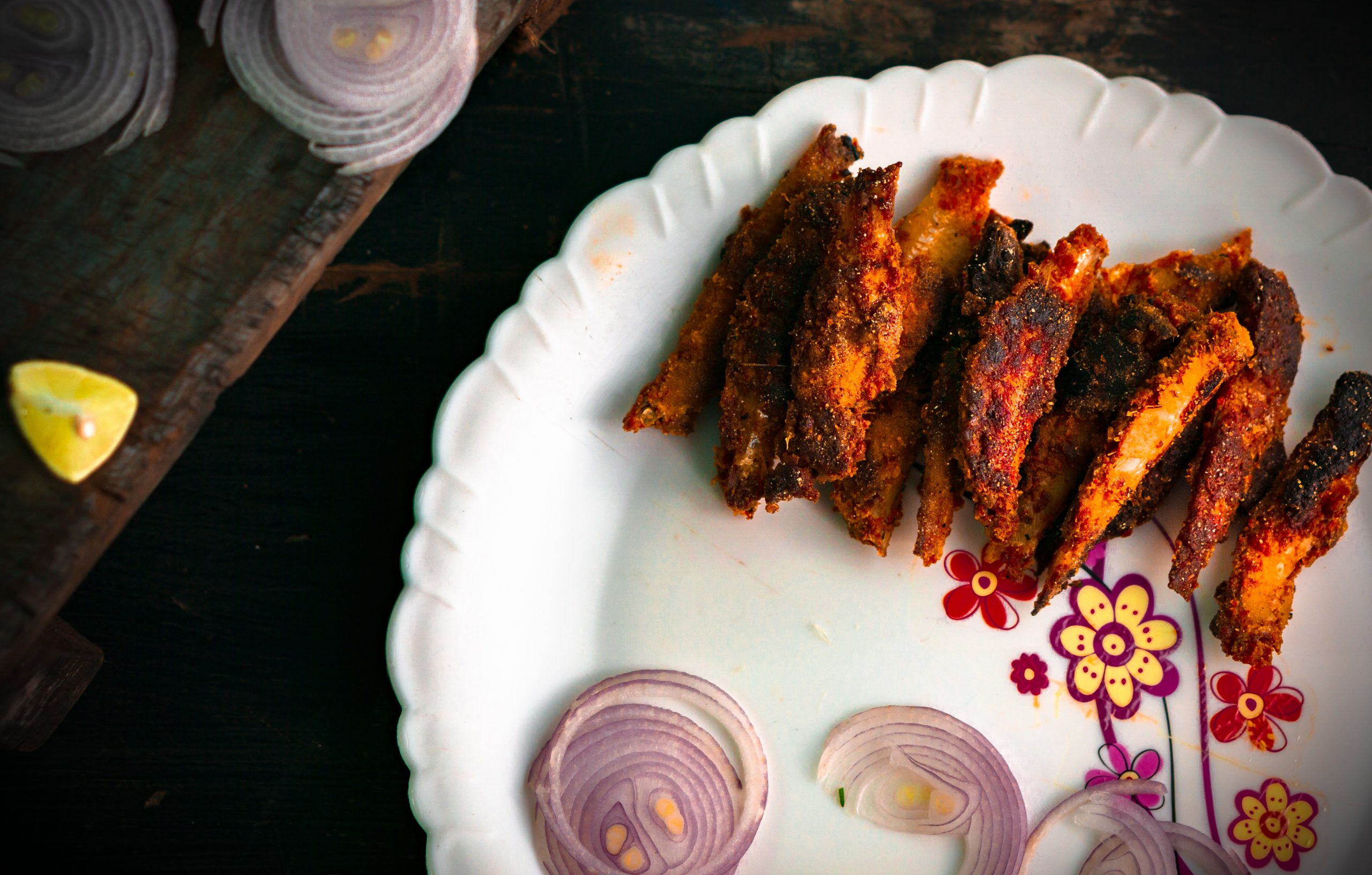 Fried fish with onions.