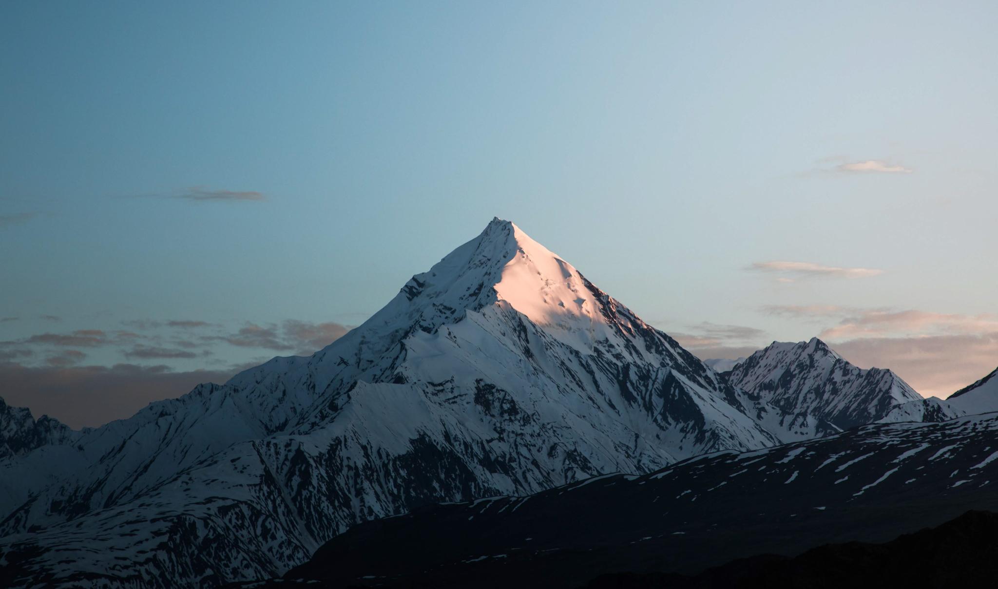 sun rays on snowy peaks