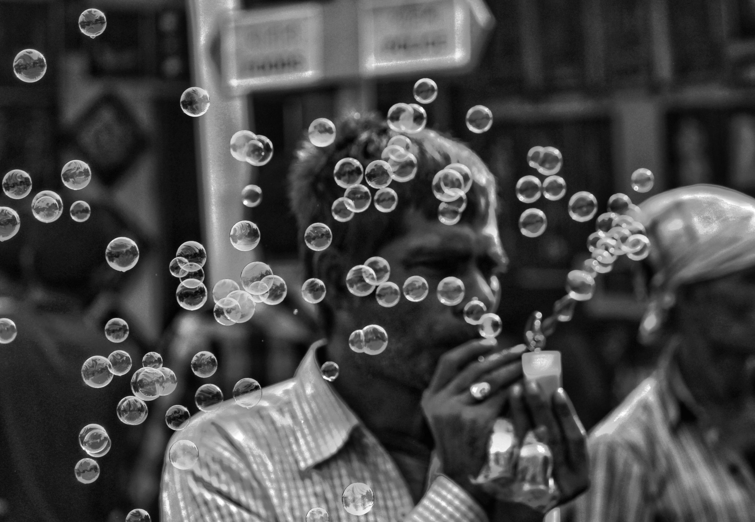 Man Playing Bubbles Black-and-White