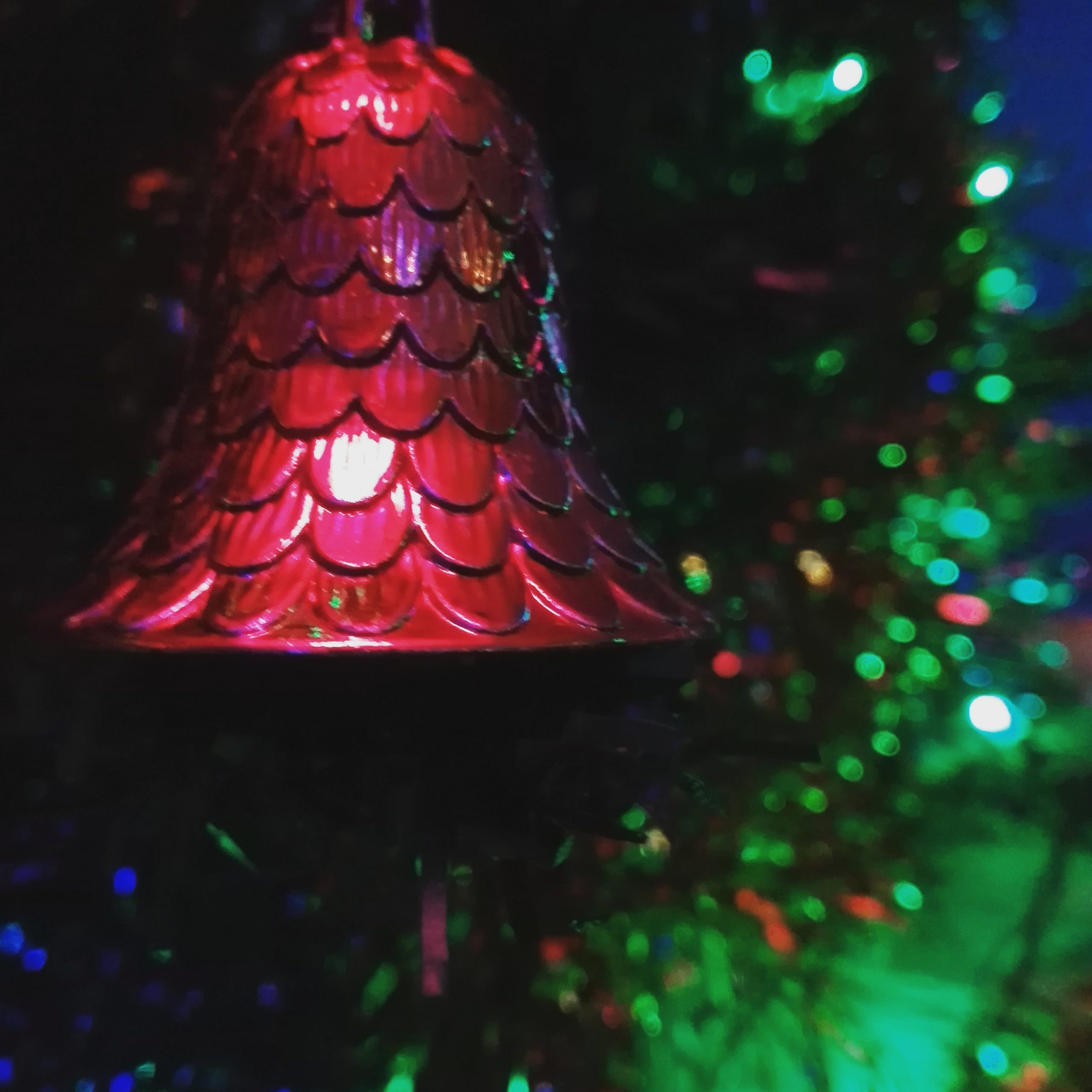 bell hanging on a Christmas tree