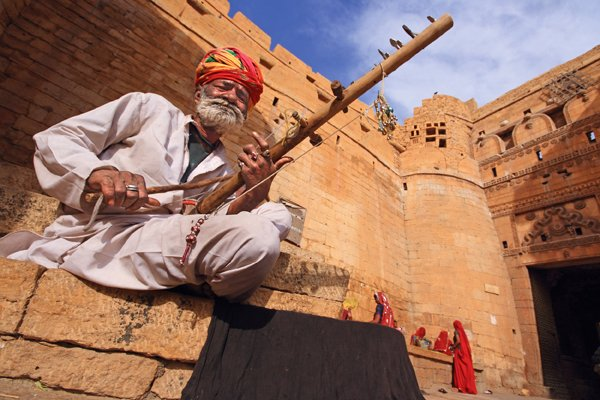 a folk musician playing his musical instrument