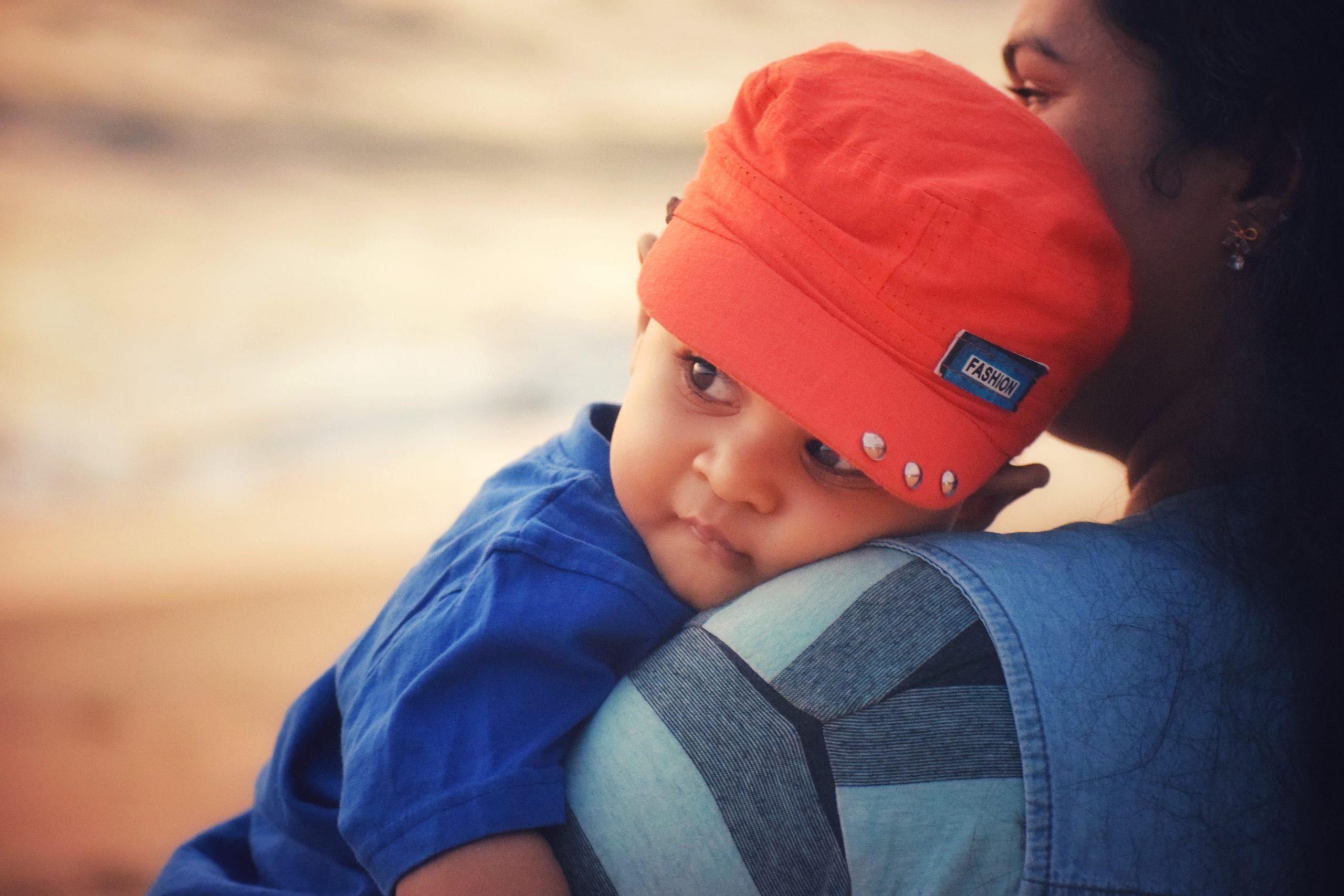 Baby boy with orange cap