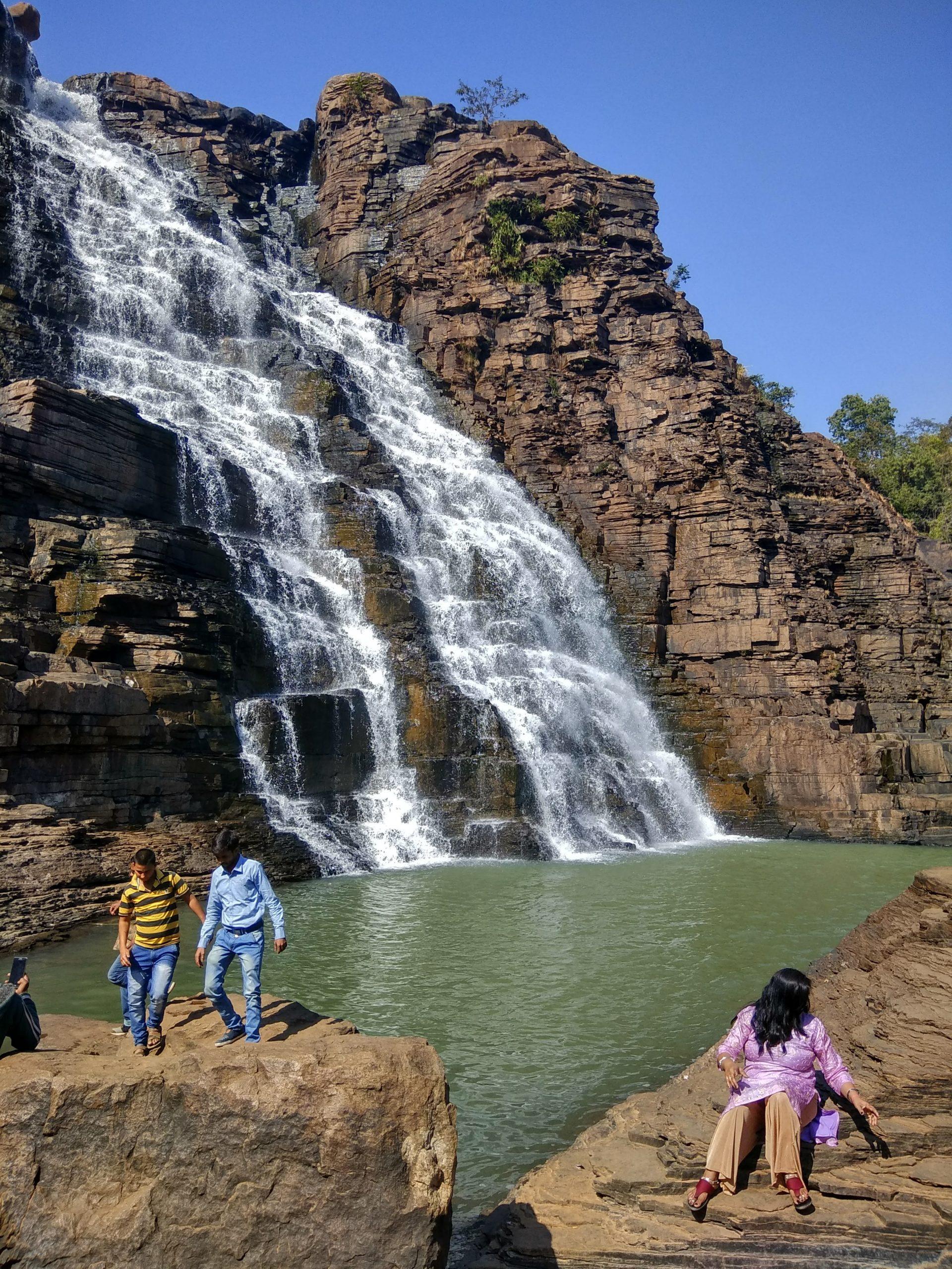 tourists near a waterfall