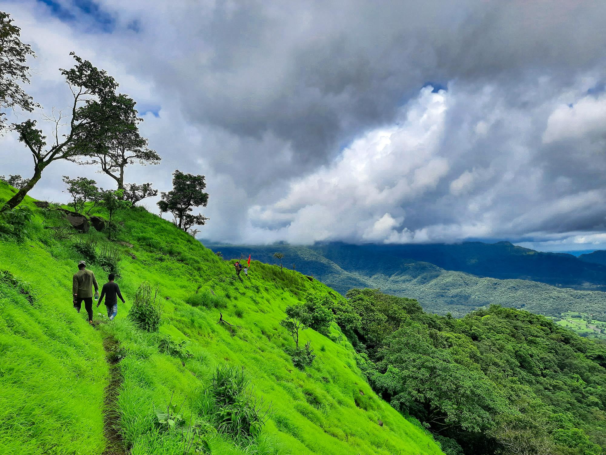Father & son trekking in Shayadri mountains.