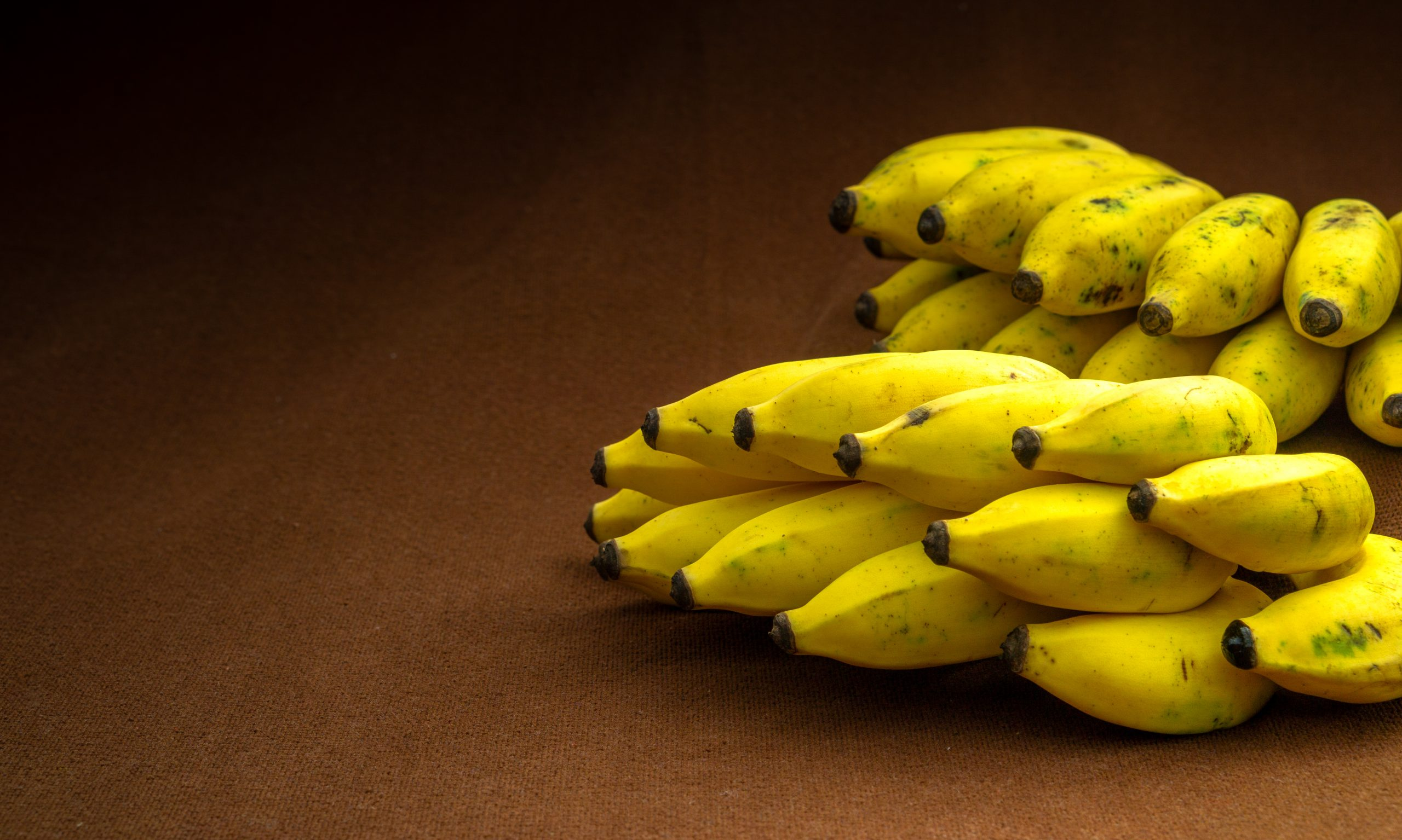 Bunch of bananas on a table.