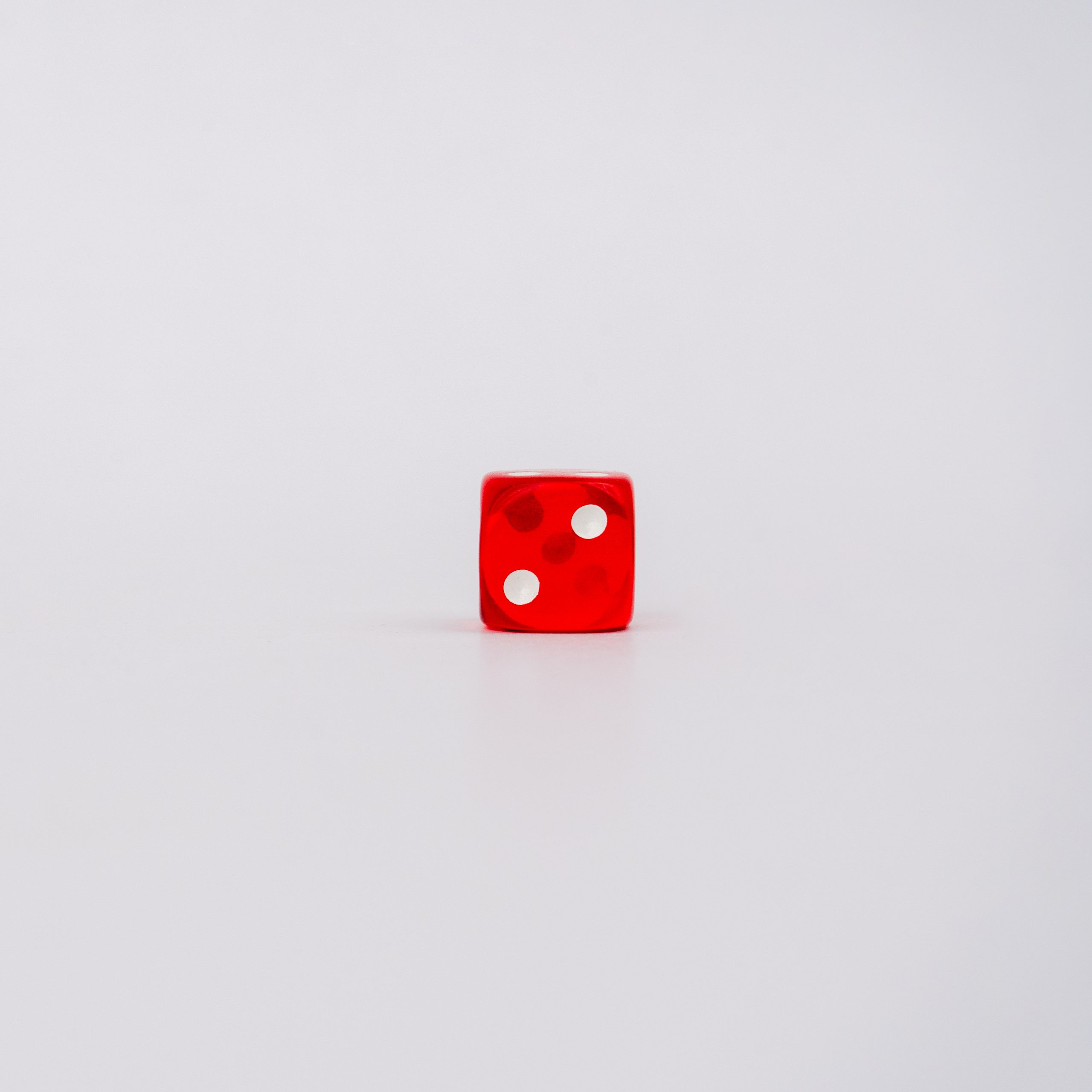 Two on red dice on white background