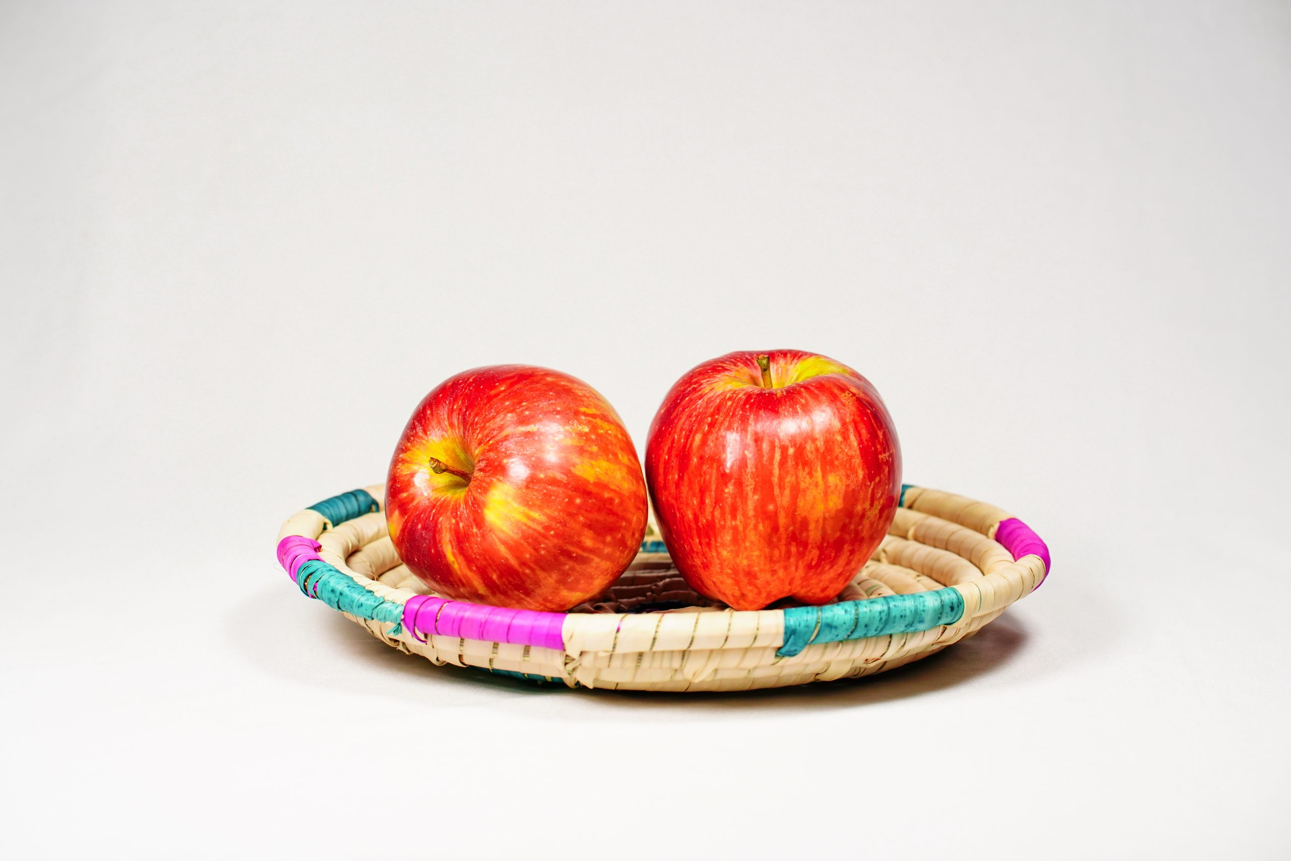 Two red apple in basket