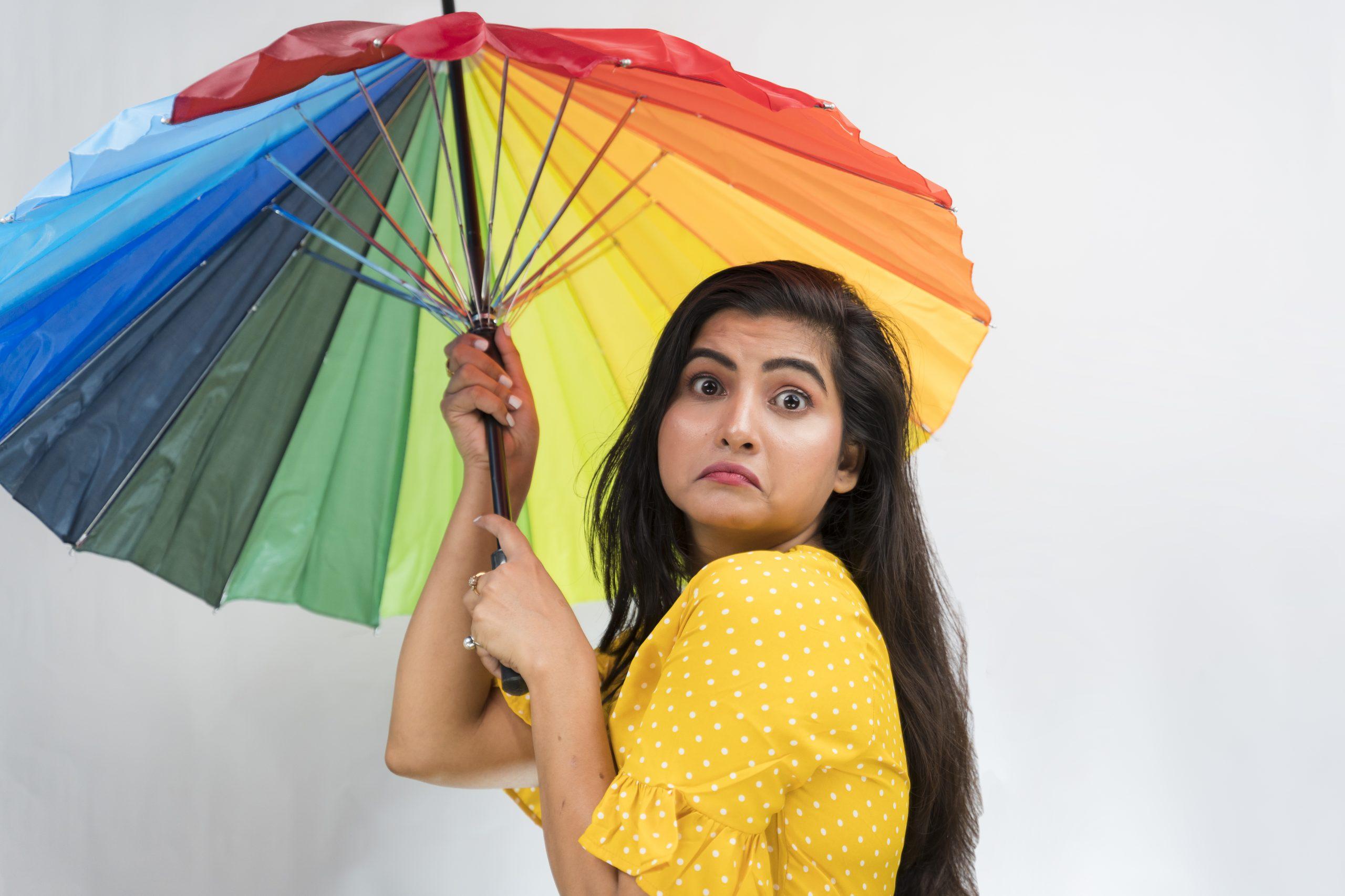 Unhappy girl with umbrella
