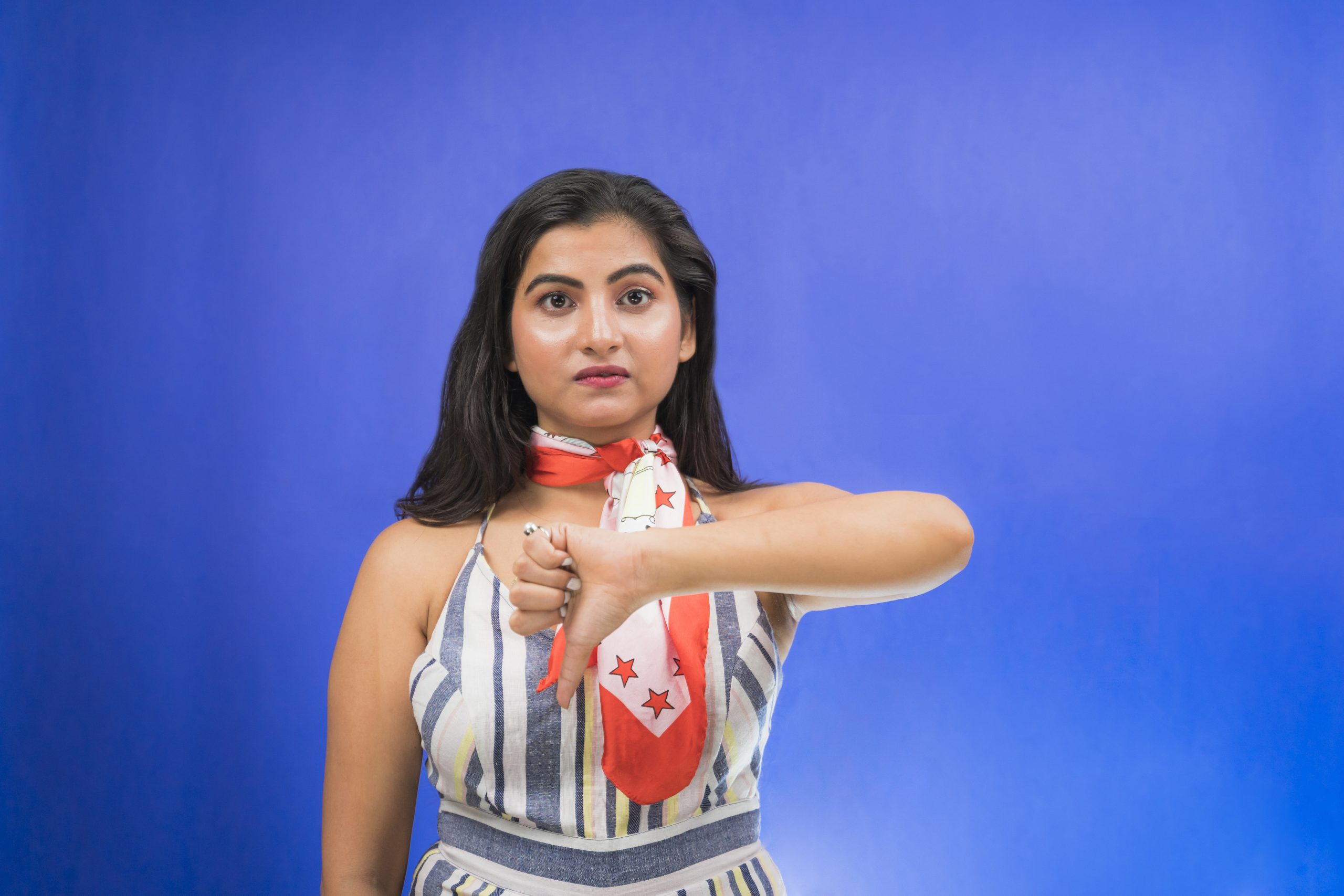 Unhappy indian girl doing thumbs down