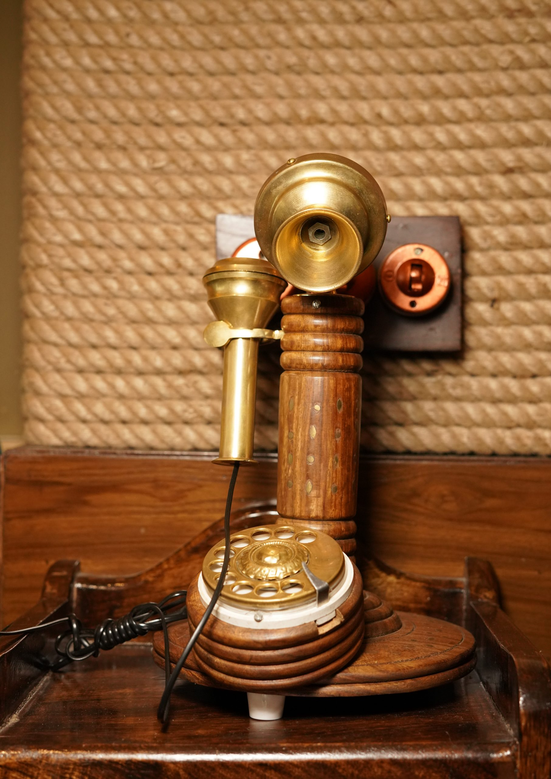 Antique telephone on a table.