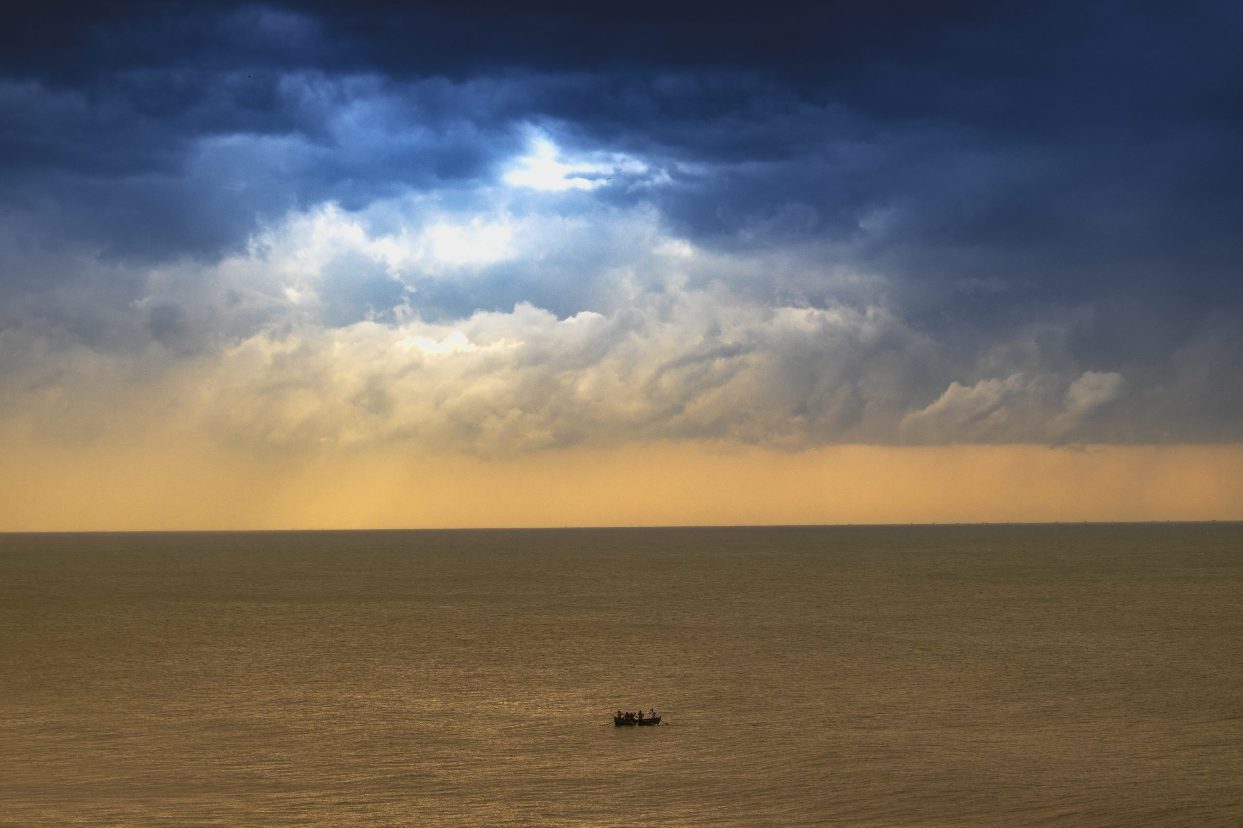 Boat in the Sea on a Cloudy Day