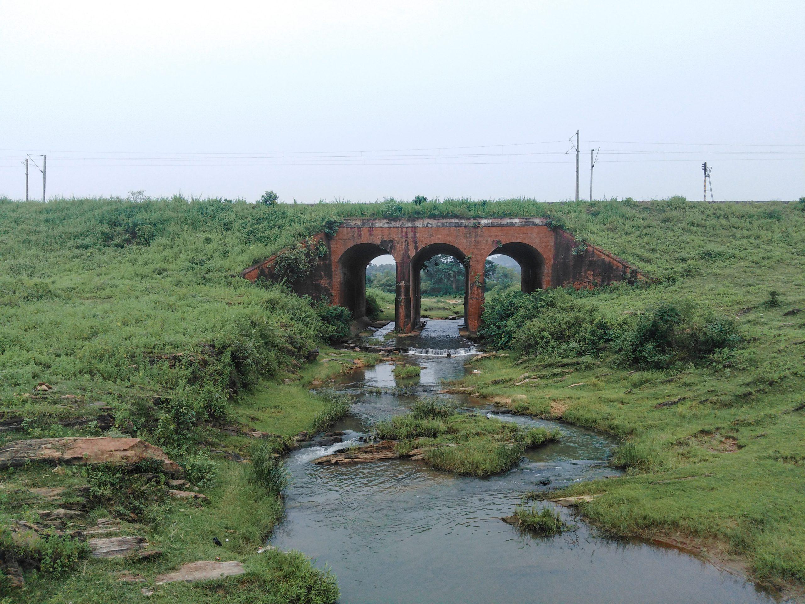 Water flowing under an arch bridge