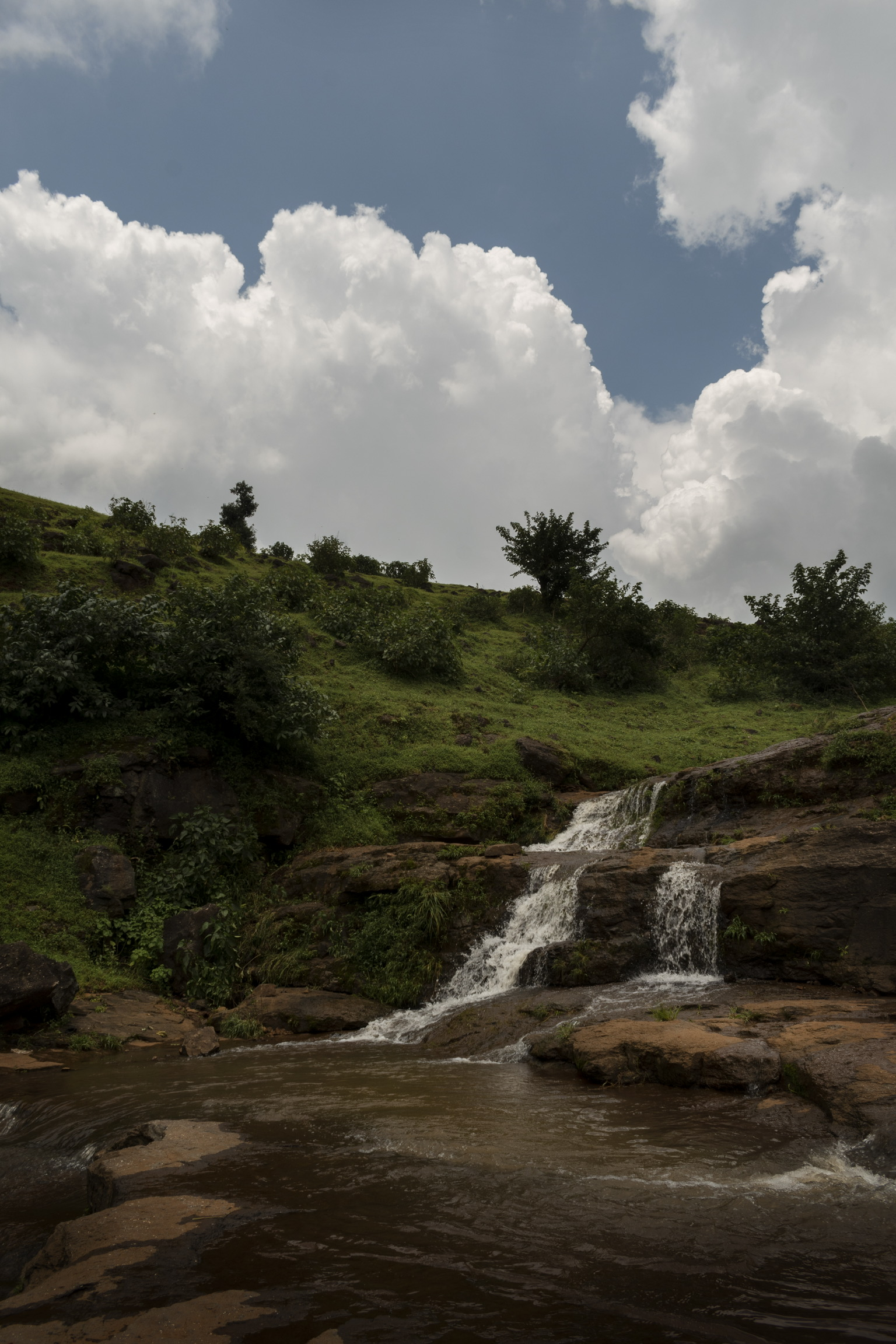 Waterfall and Clouds Scenery