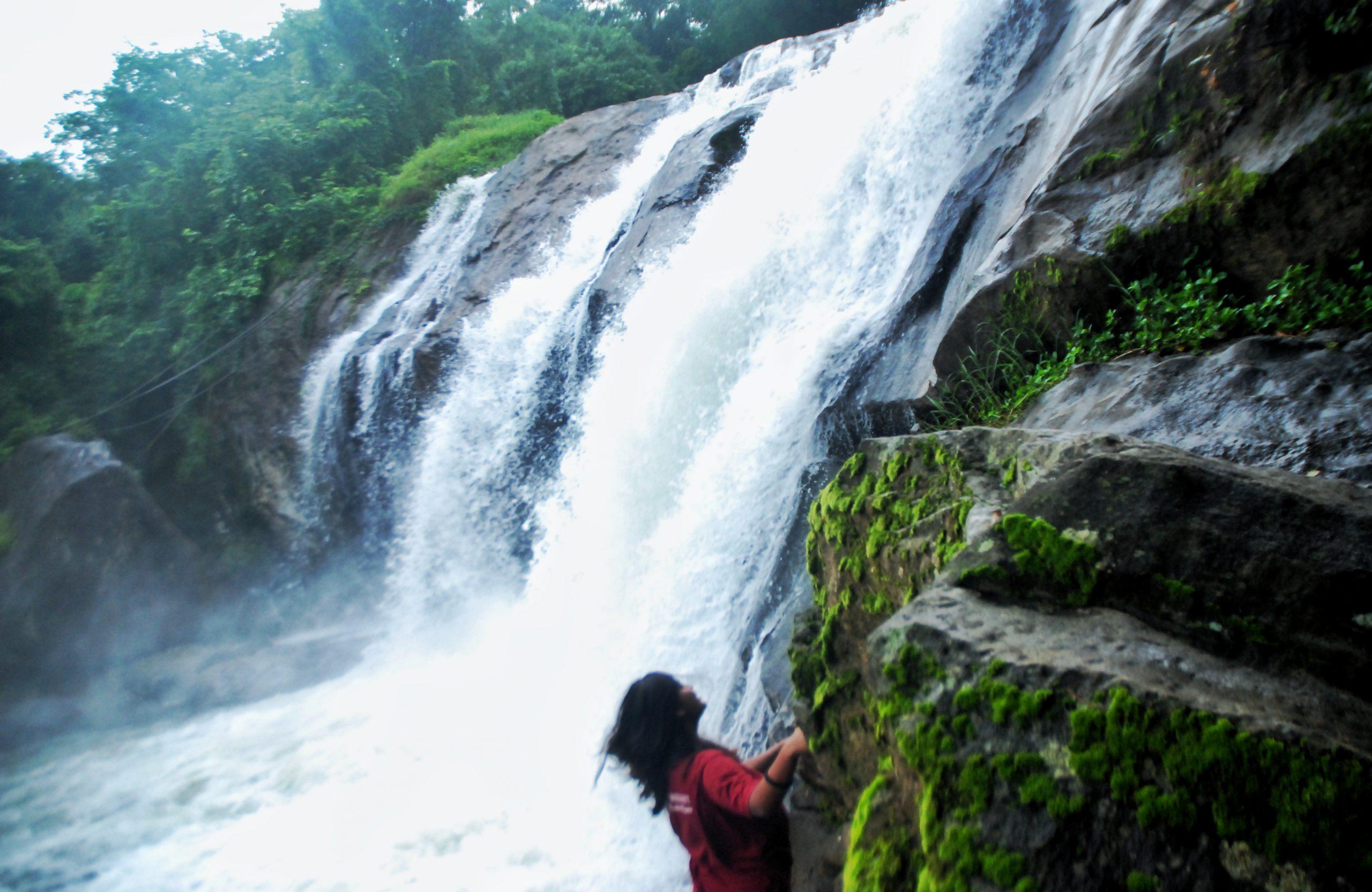 girl enjoying at waterfalls