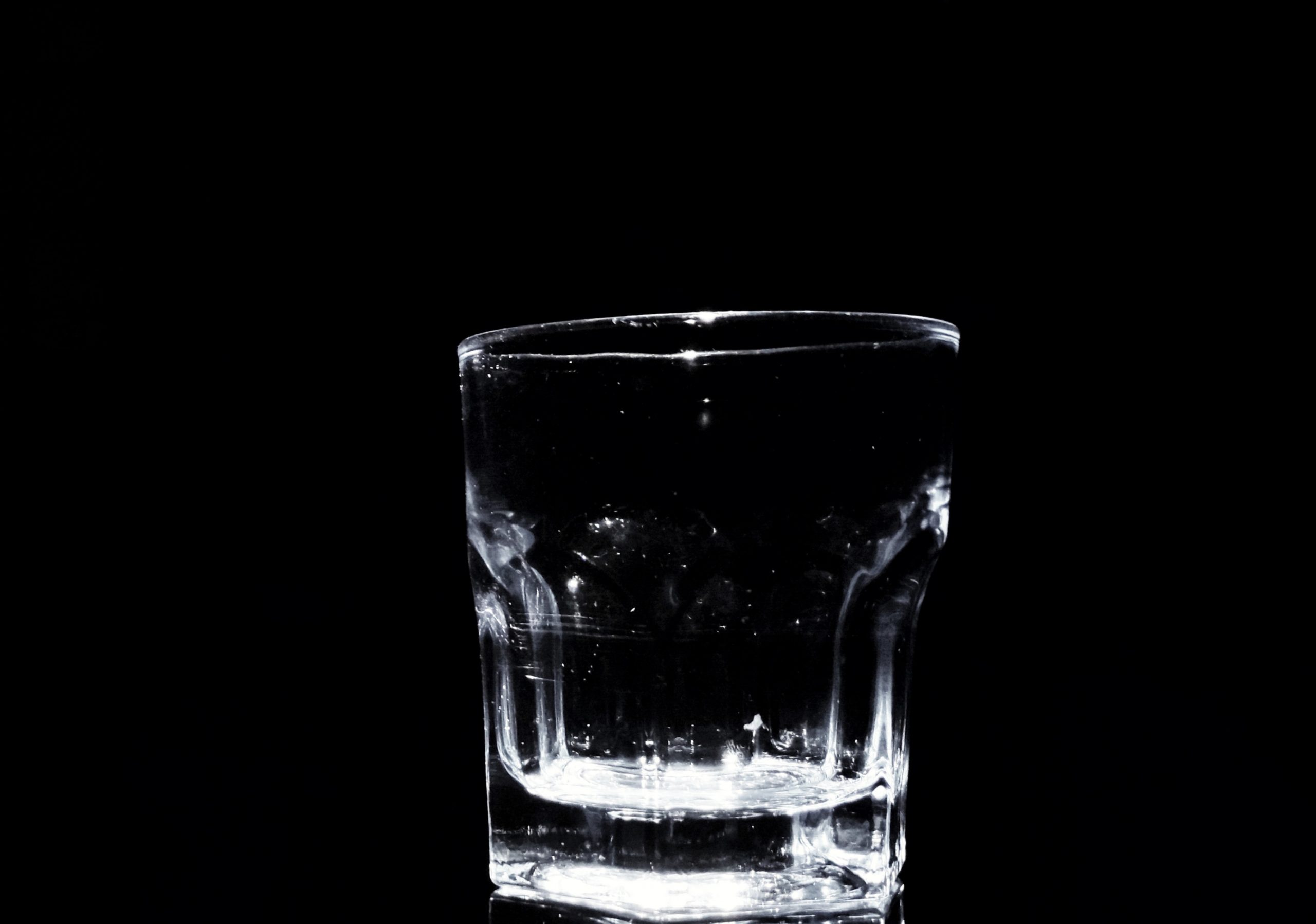 Whiskey glass with black background