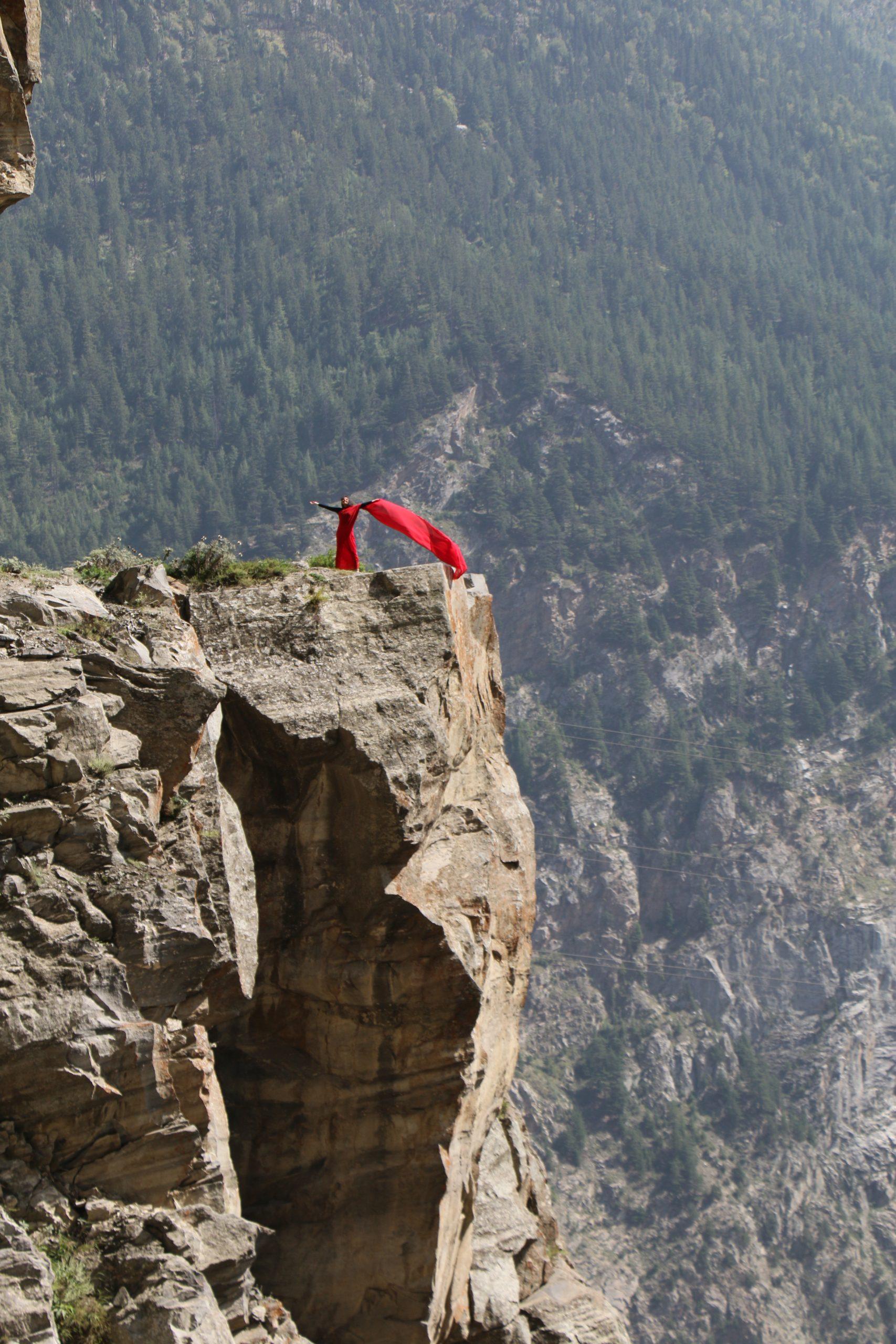 Indian Woman in Saree on Himalaya Rock Mountains