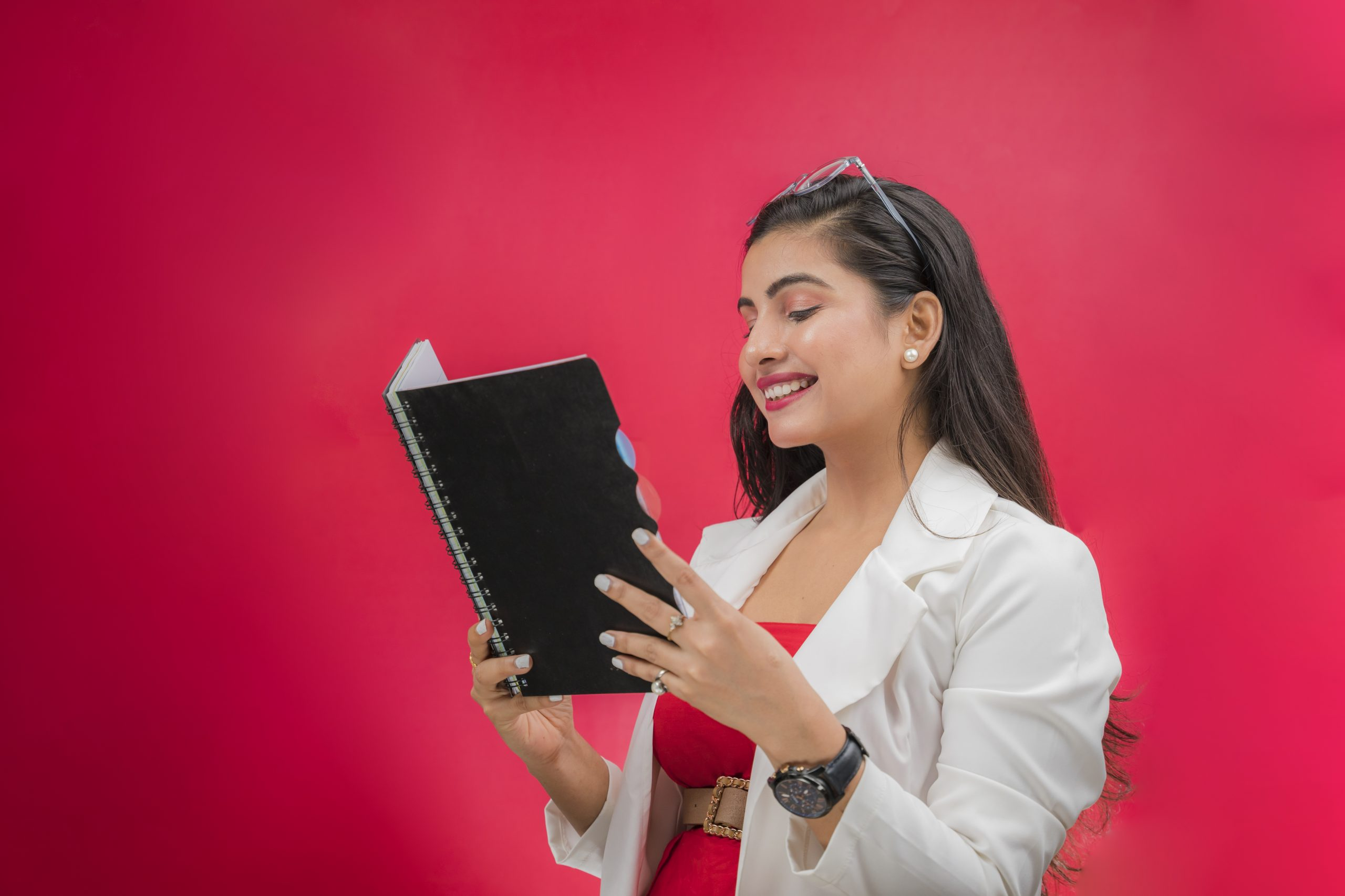 Woman smiling while reading book
