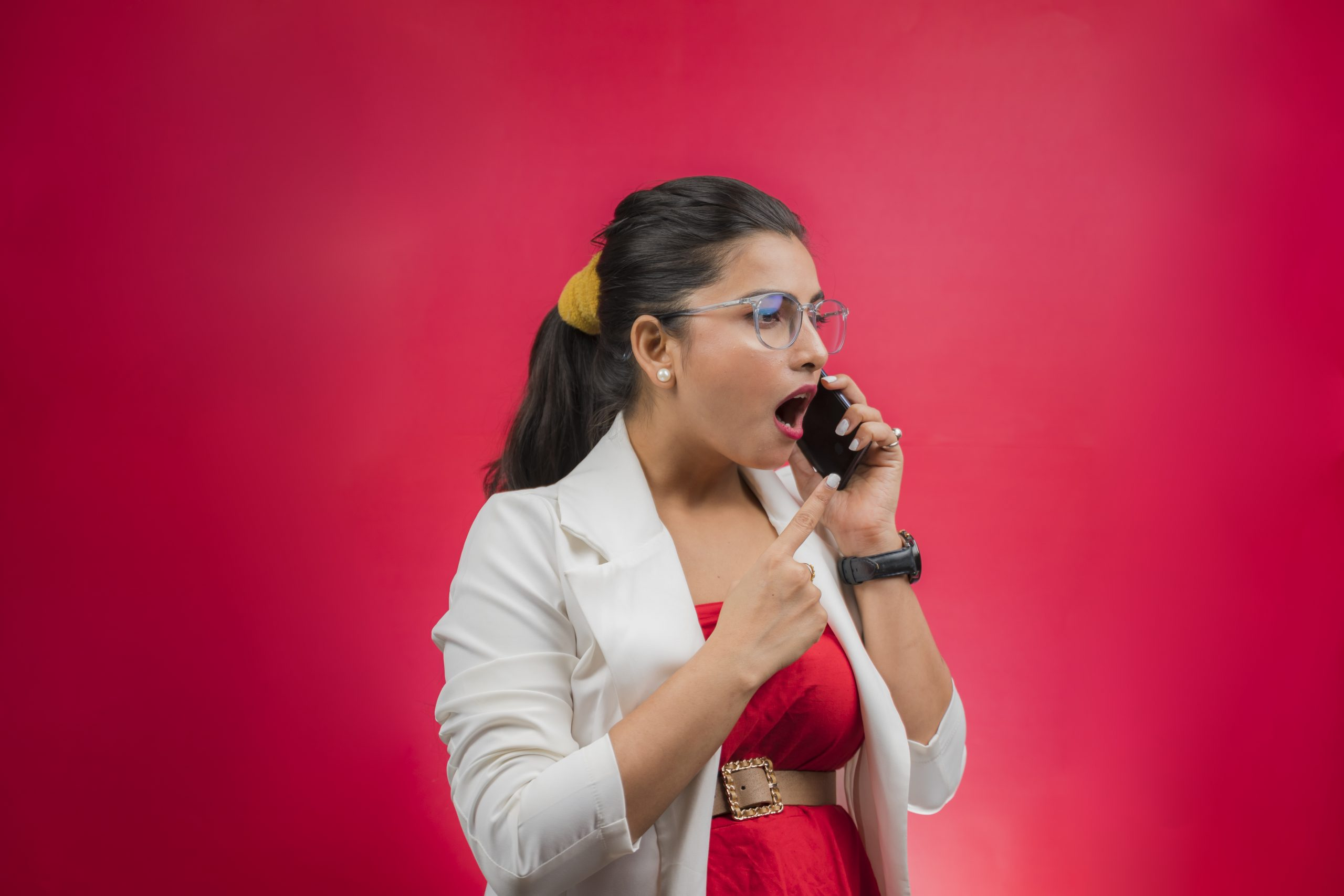 Professional woman shouting on phone