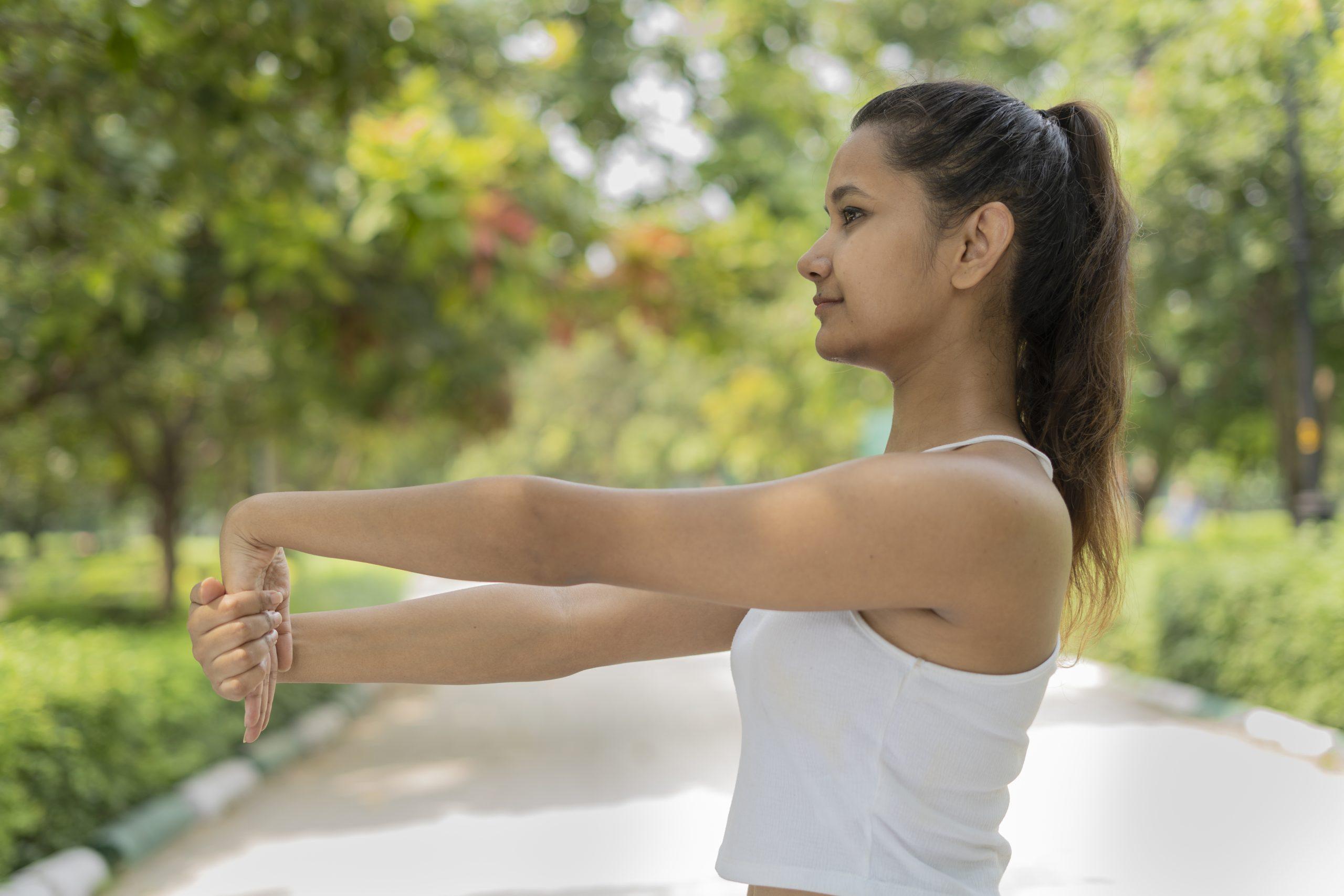 girl stretching wrist