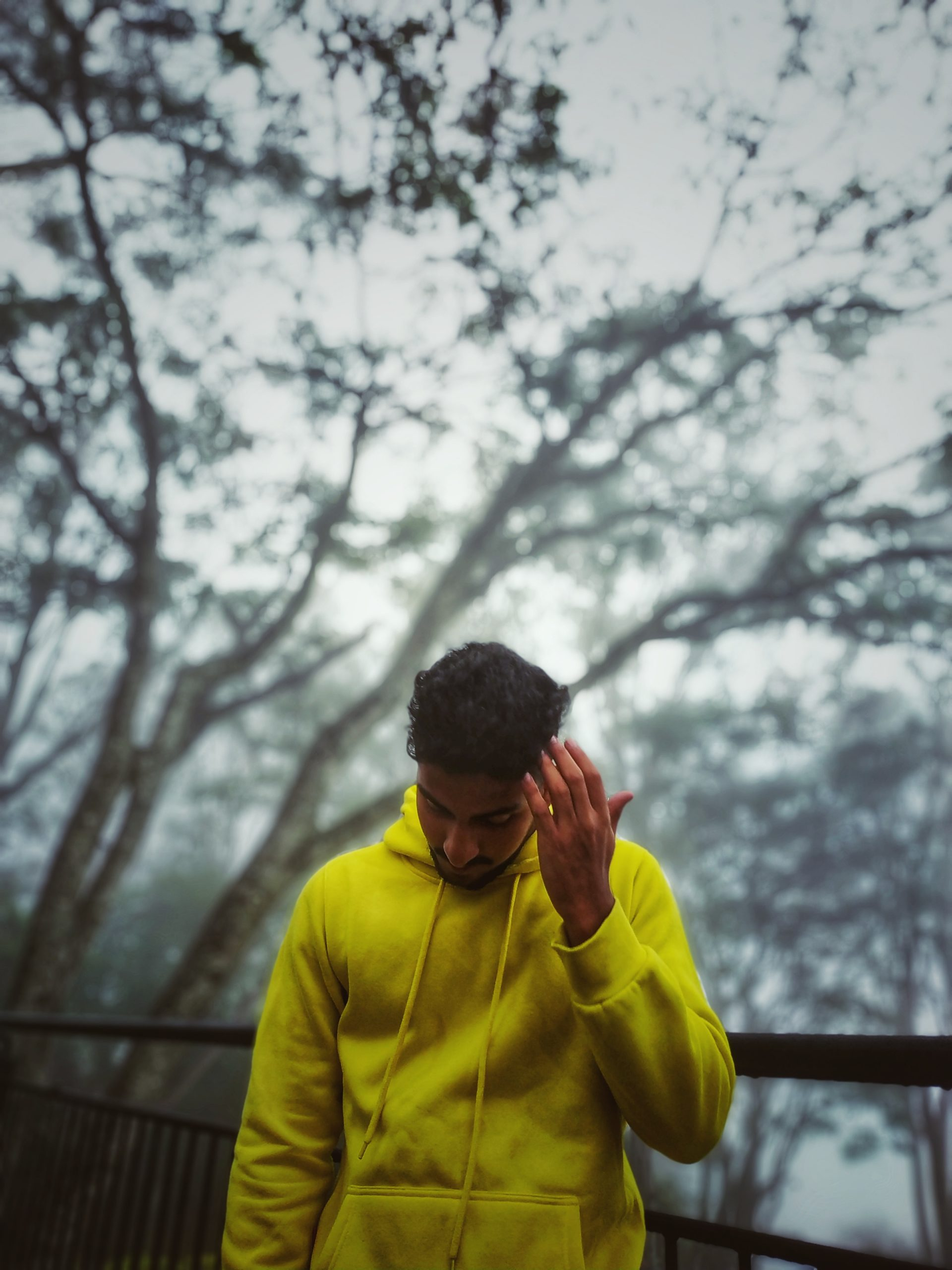Man wearing a yellow sweater