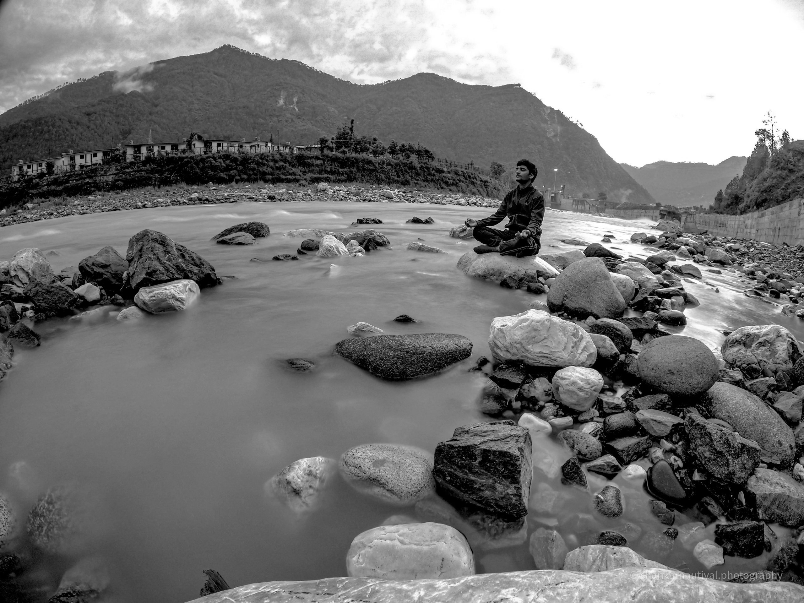 Yoga on river rocks
