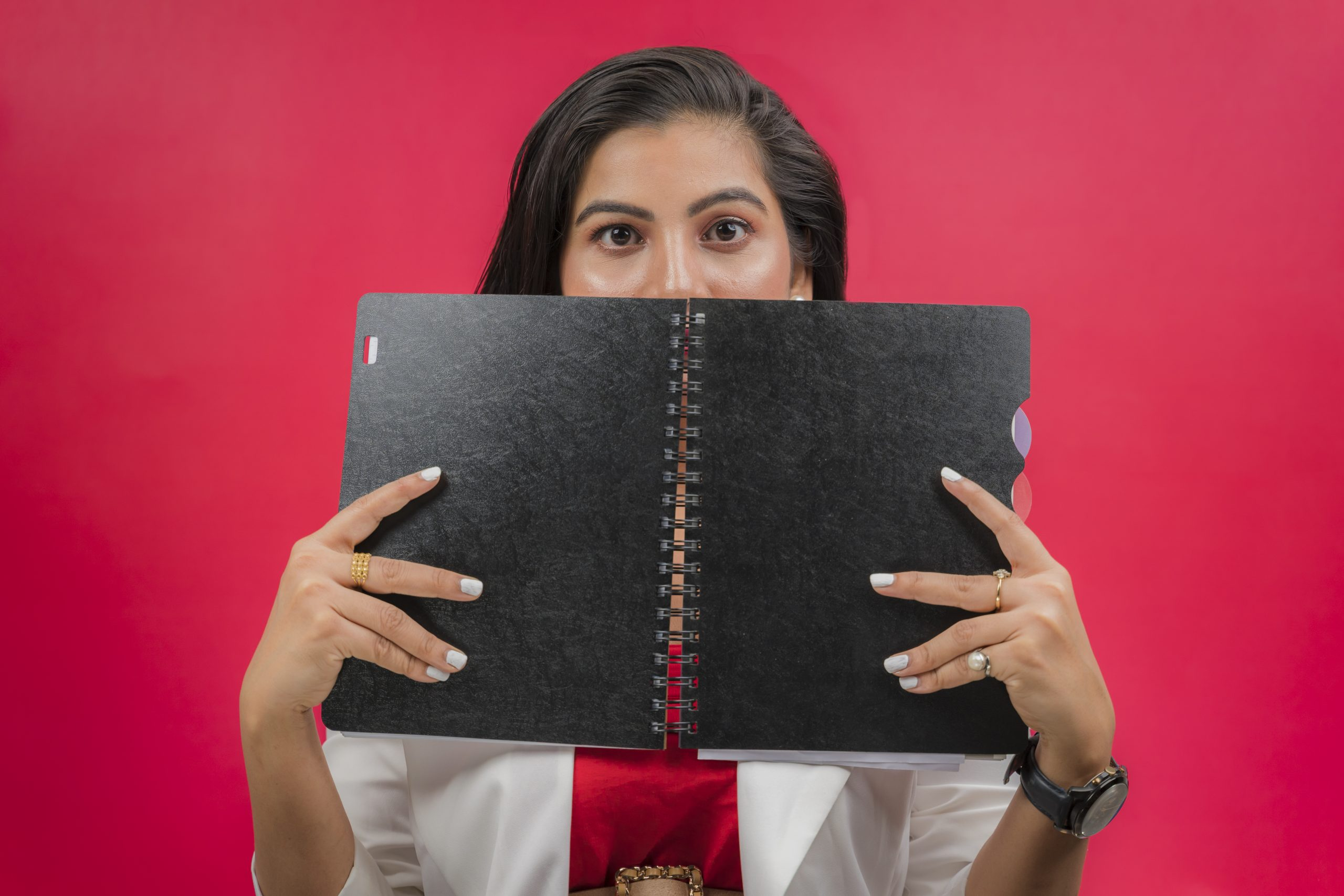 Young girl holding notebook