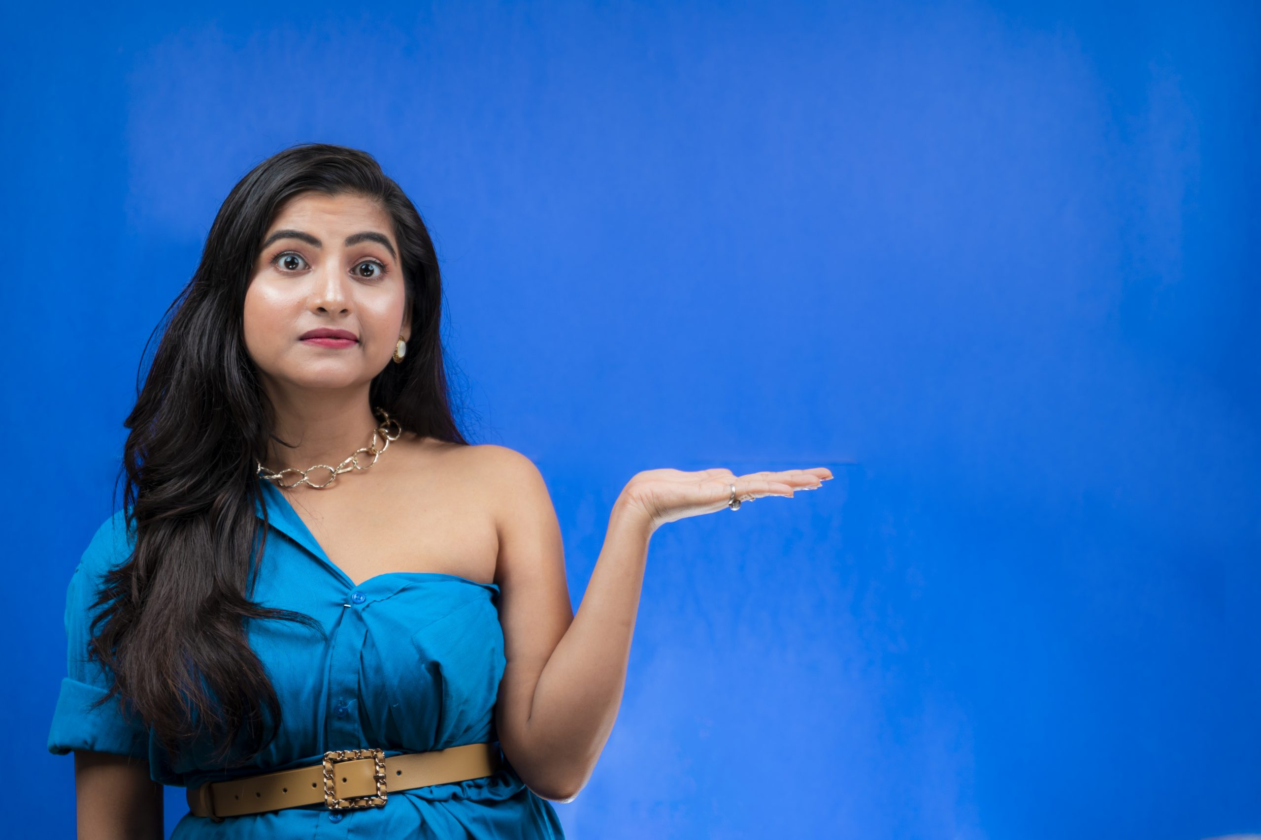 Young girl pointing hand sideways