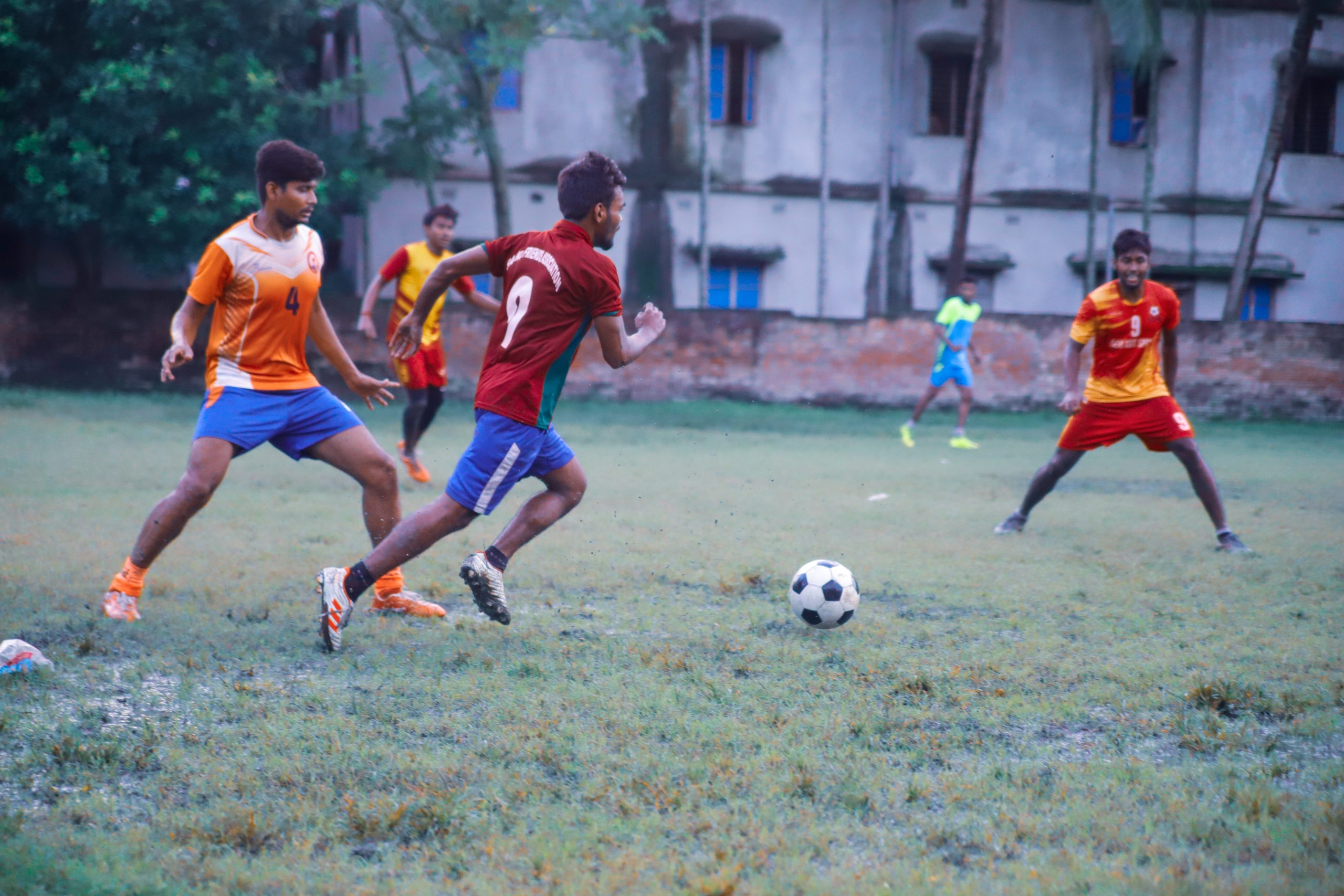 Young men playing football in Kolkata
