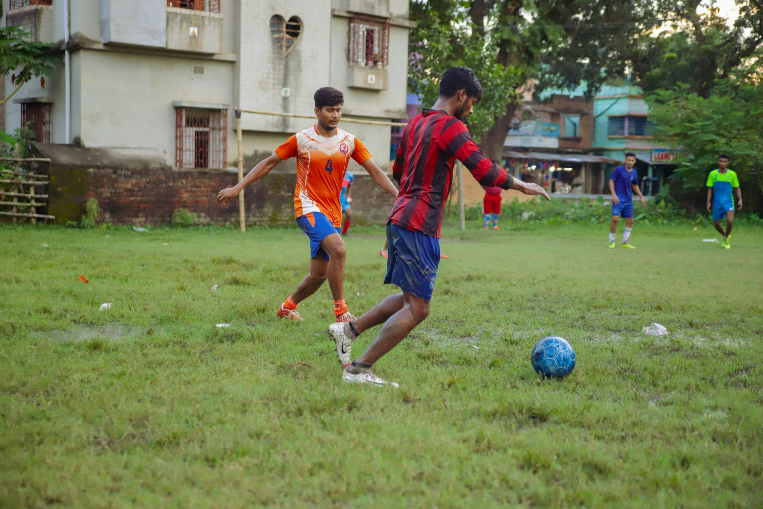 Young men playing soccer in Kolkata