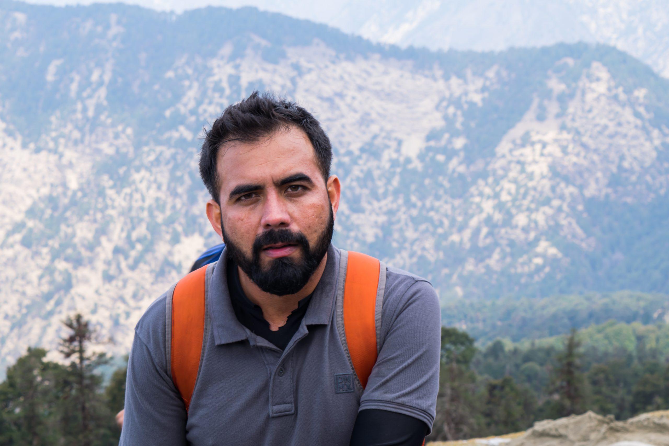 A man trekking in the hills