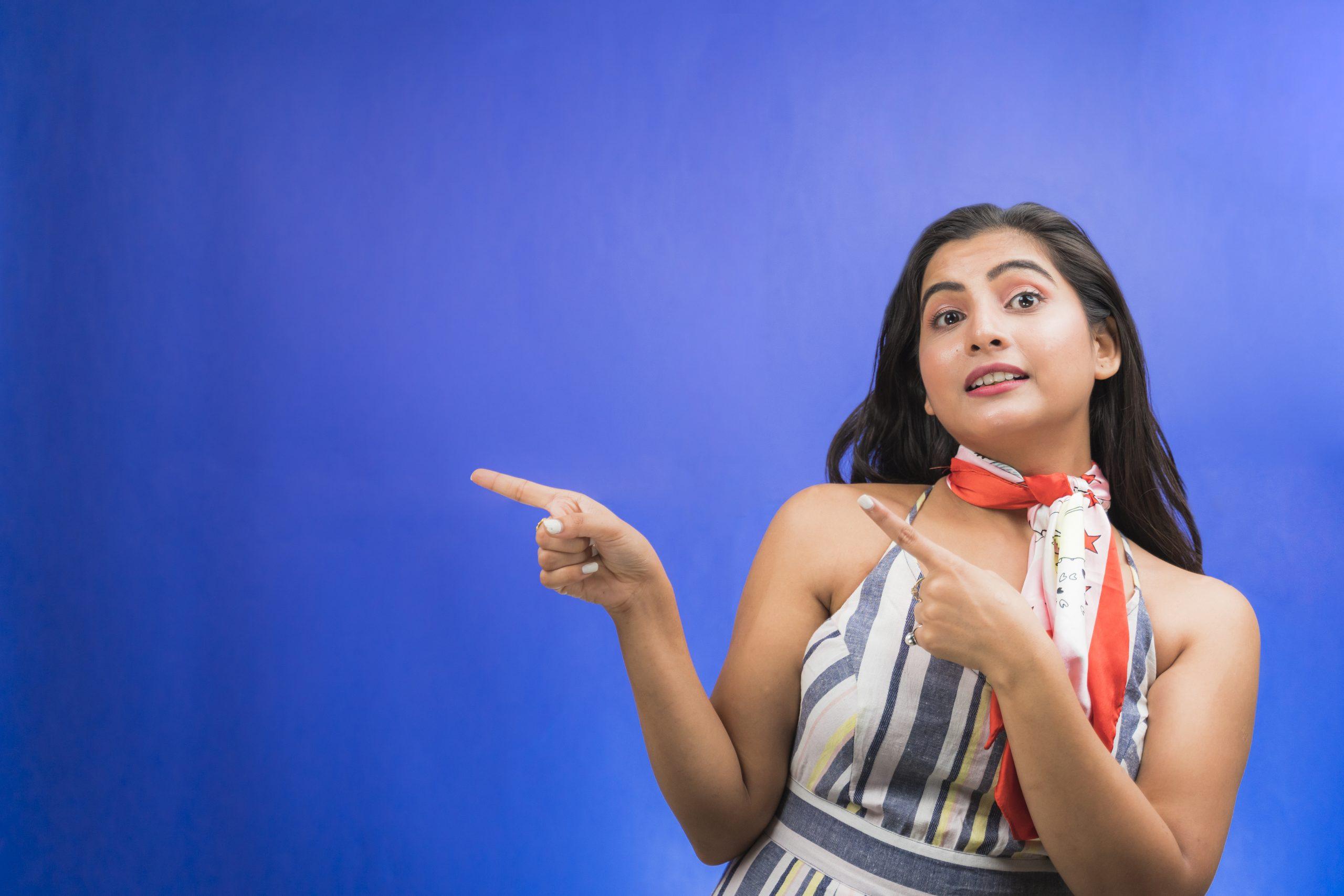 indian girl pointing sideways