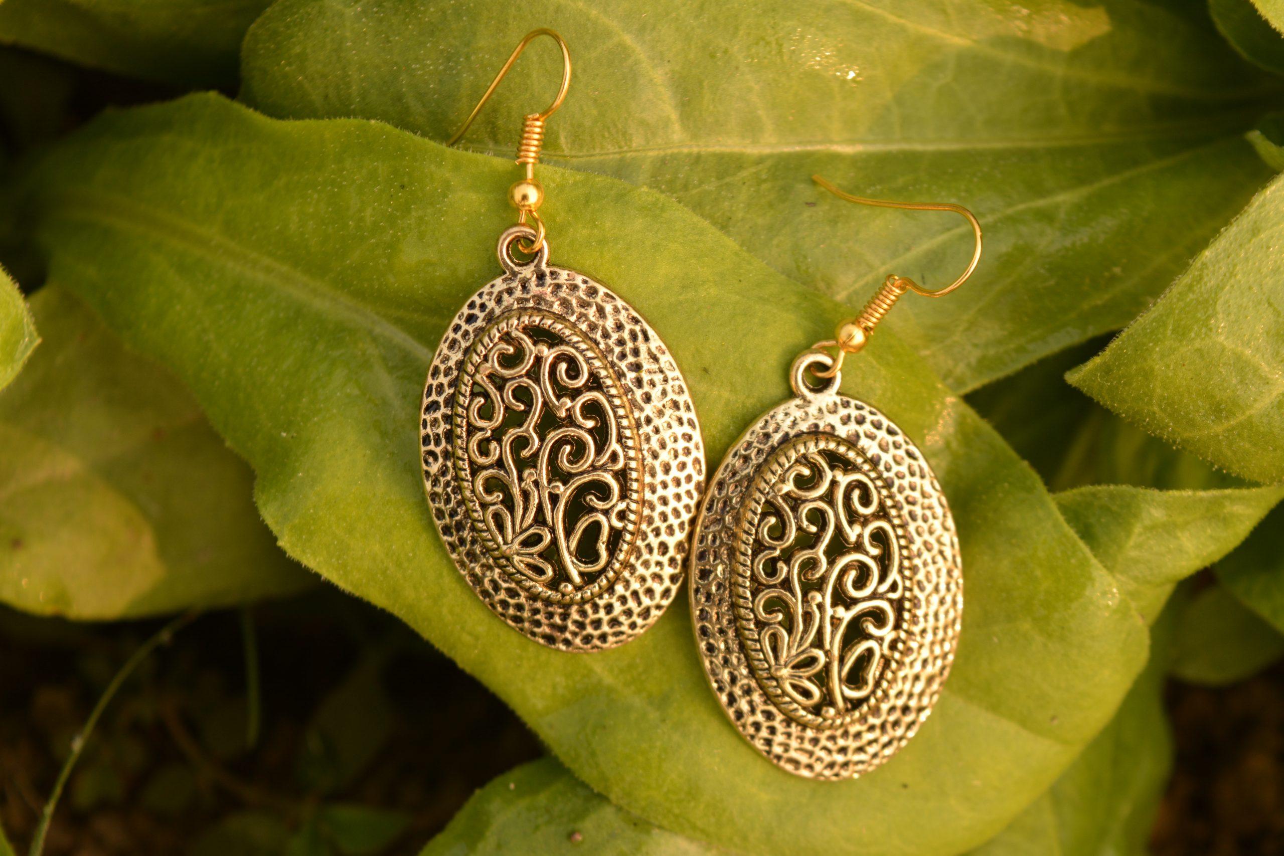 Earrings on a leaf