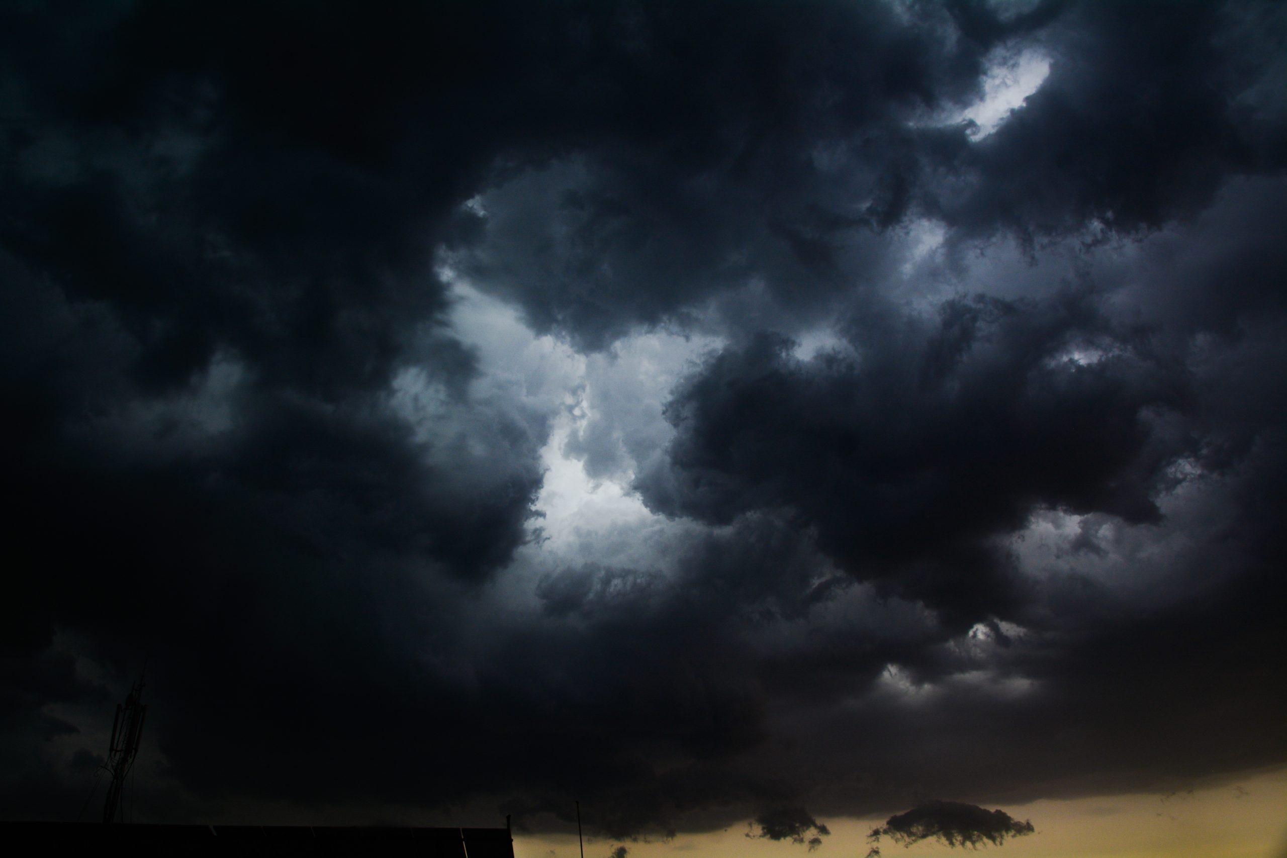 lightning of the thunder in between the moody dark sky.