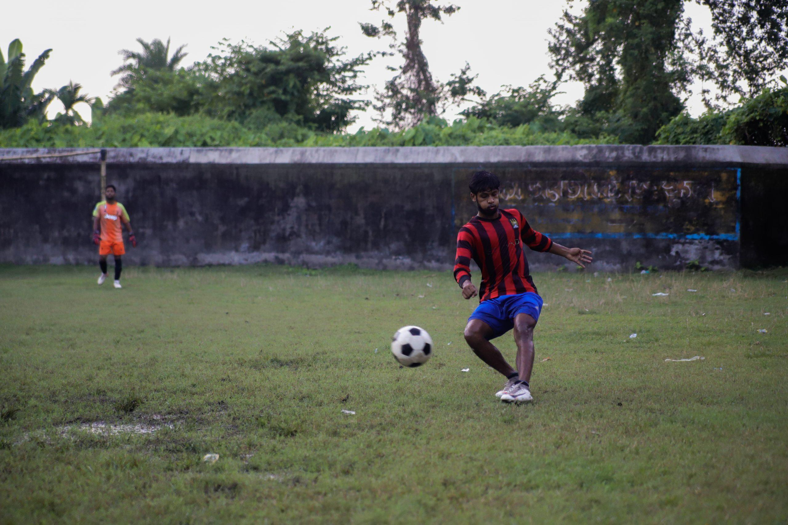 player playing football