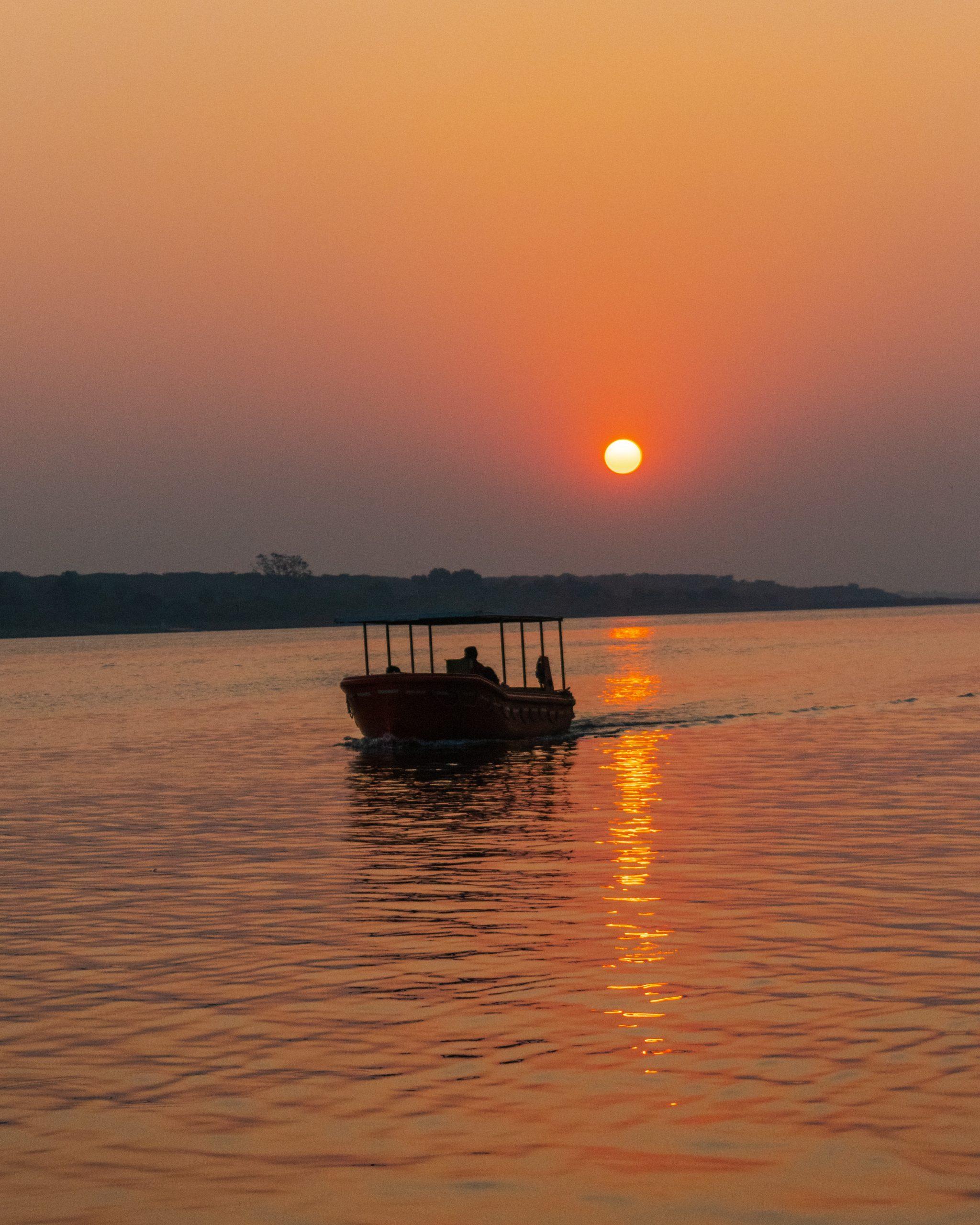 Boat sailing during sunset